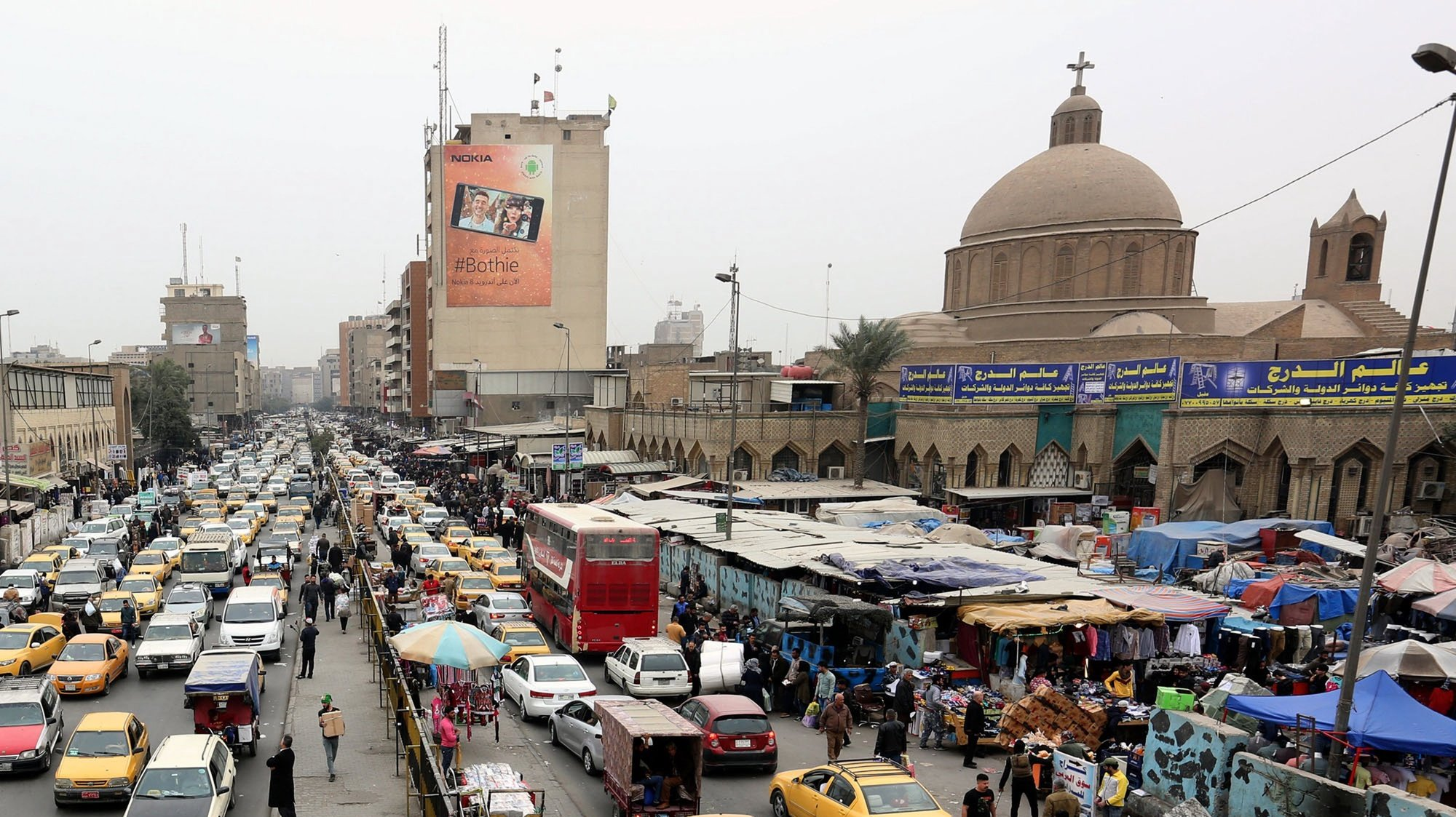 epa06521771 Vehicles drive next to Shorja market at central Baghdad, Iraq, 13 February 2018. An international donor conference was held in Kuwait on 12 February to raise funds for Iraq's reconstruction following its three-year war against Islamic State (IS), as the Iraqi government said it would need an estimated 88.2 billion US dollars for reconstruction.  EPA/ALI ABBAS