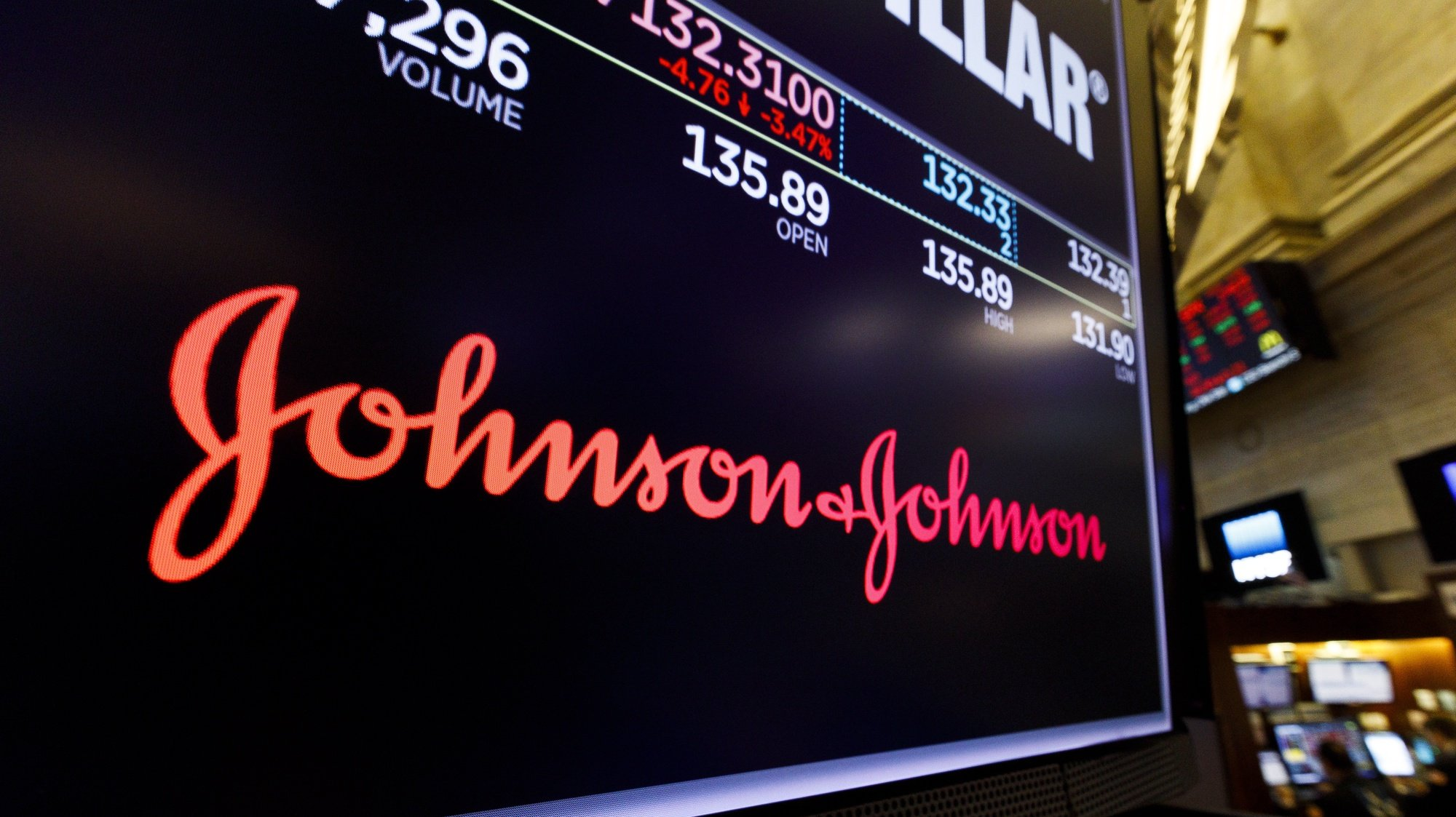 epa09041618 A screen shows the logo for the pharmaceutical company Johnson and Johnson on the floor of the New York Stock Exchange in New York, New York, USA, 29 May 2019 (reissued 27 February 2021). The Johnson and Johnson new single shot Covid-19 vaccine has been approved for use in the US by the US Food and Drug Administration on 27 February 2021.  EPA/JUSTIN LANE *** Local Caption *** 55233447