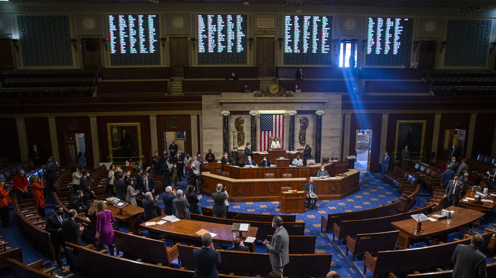 epa09066222 A view of the house chambers as Speaker of the House Nancy Pelosi presides over the House vote on the 1.9 trillion US dollars coronavirus relief plan on the House floor of the US Capitol in Washington, DC, USA,10 March 2021. The coronavirus relief package, passed on a party line vote, provides money for direct payments to individuals, state and local governments, vaccine distribution, jobless benefits and child tax credits.  EPA/SHAWN THEW