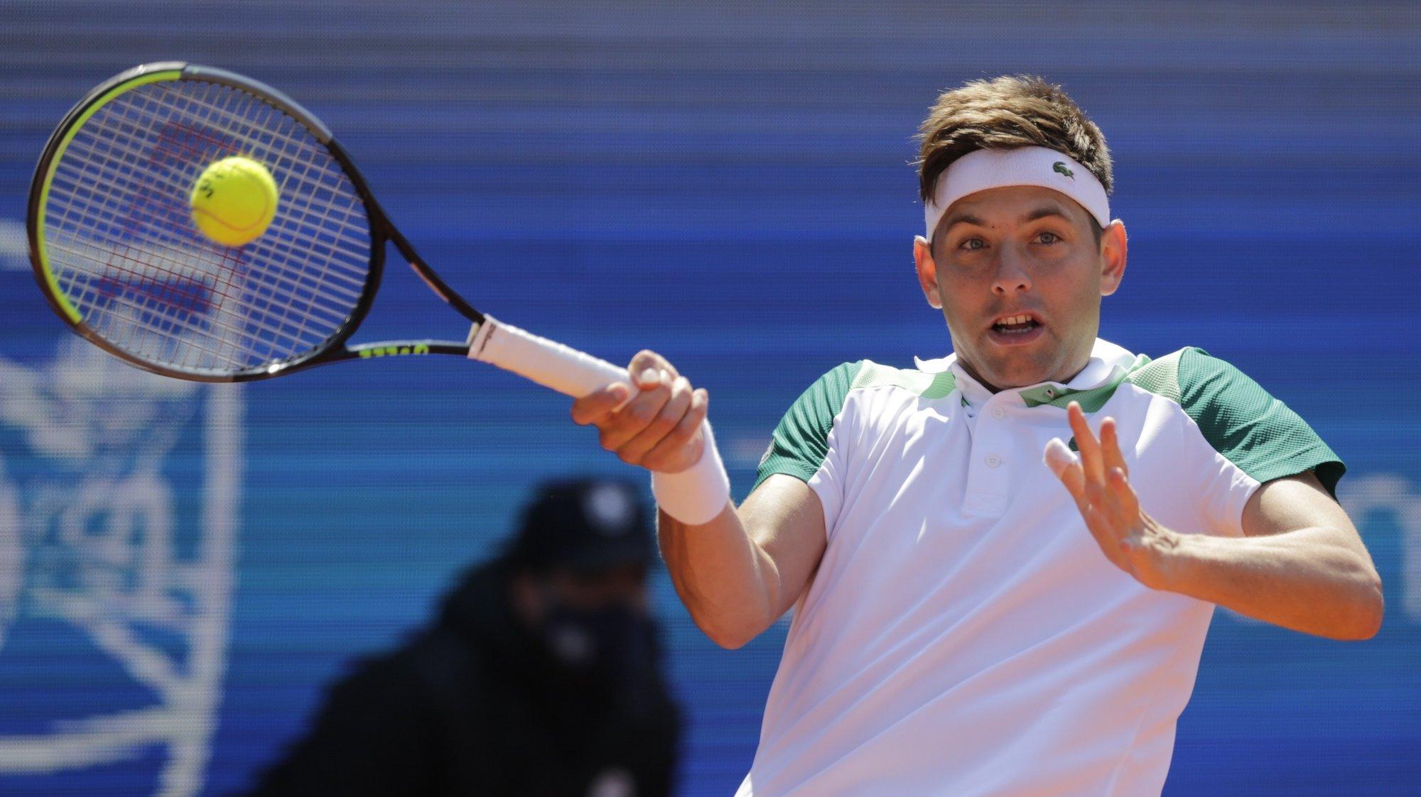 epa09154773 Filip Krajinovic of Serbia in action against Matteo Berrettini of Italy during their quarter final match of the Serbia Open tennis tournament in Belgrade, Serbia, 23 April 2021.  EPA/ANDREJ CUKIC