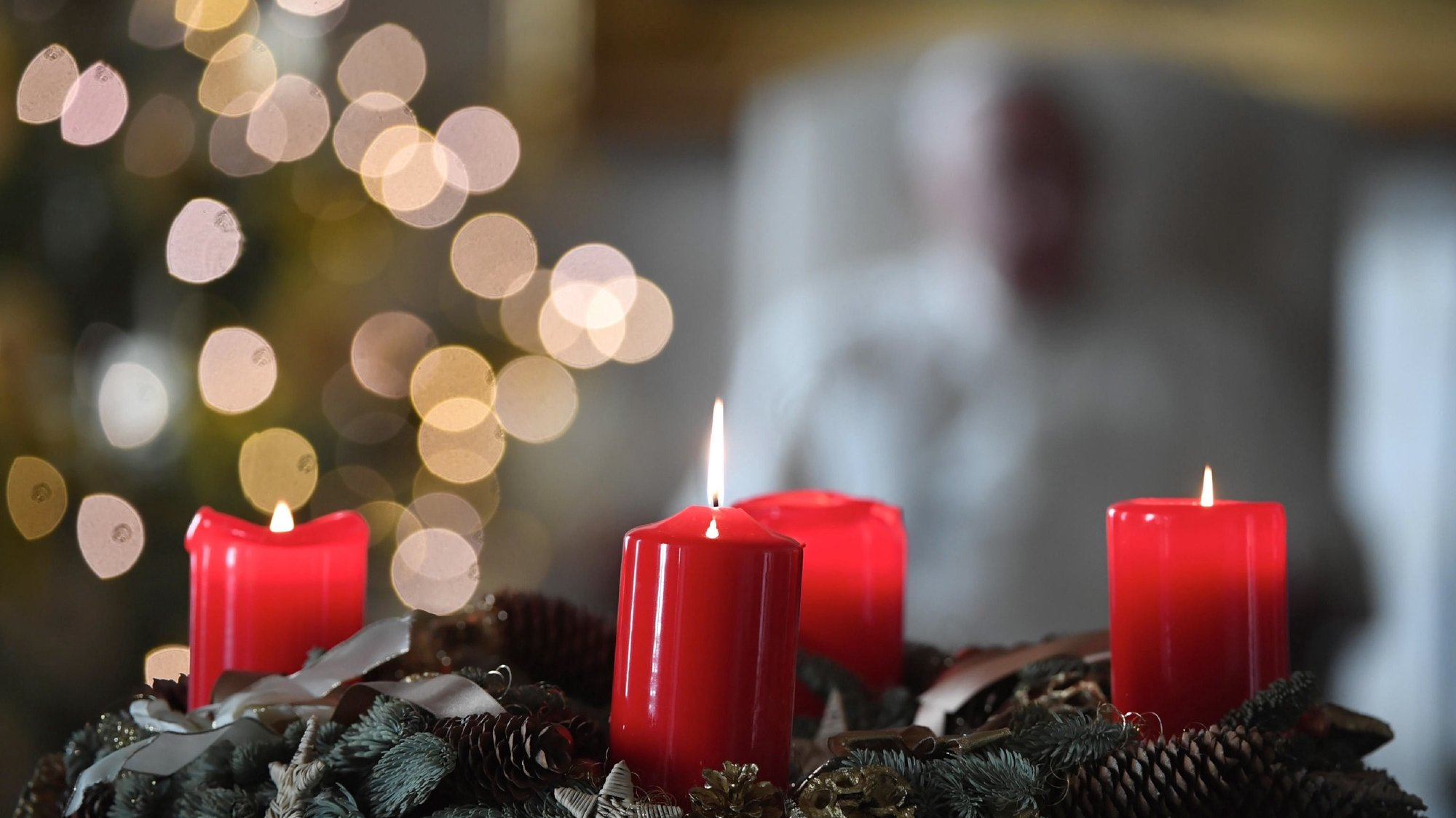 epa08900807 A handout picture provided by the Vatican Media shows candles as Pope Francis (rear, out of frame) holds his weekly general audience at Biblioteca del Palazzo Apostolico library in Vatican City, 23 December 2020.  EPA/VATICAN MEDIA HANDOUT  HANDOUT EDITORIAL USE ONLY/NO SALES