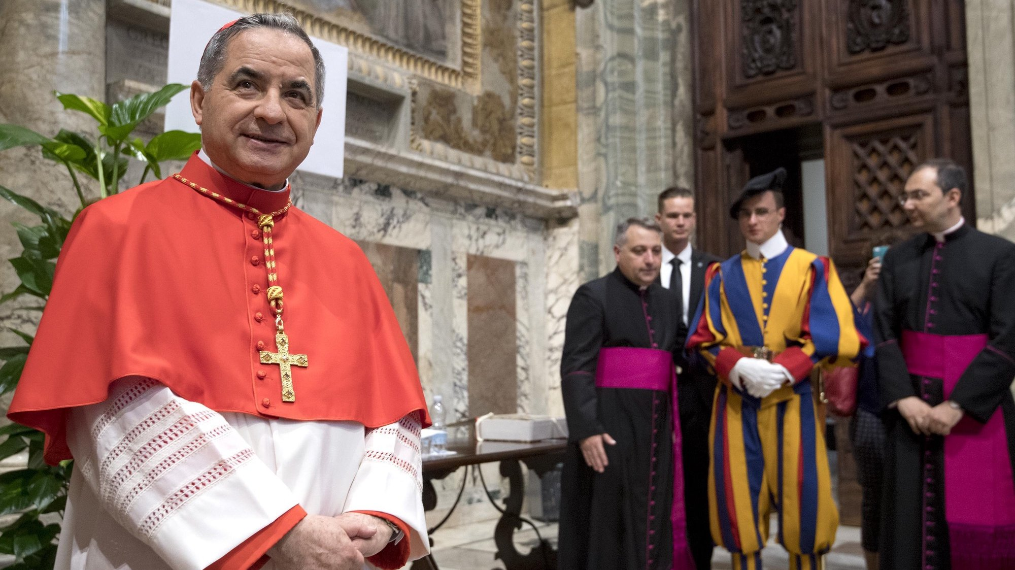 epa06848346 Substitute of the Vatican Secretary of State and Special Delegate for the Sovereign Military Order of Malta from Italy, Giovanni Angelo Becciu (L) poses for photographers after the Pope Francis' Ordinary Public Consistory mass to create 14 new cardinals from 11 countries in Saint Peters Basilica at the Vatican, 28 June 2018. The cardinals-designate are from Bolivia, Iraq, Italy, Japan, Pakistan, Poland, Portugal, Peru, Madagascar, Mexico and Spain.  EPA/CLAUDIO PERI