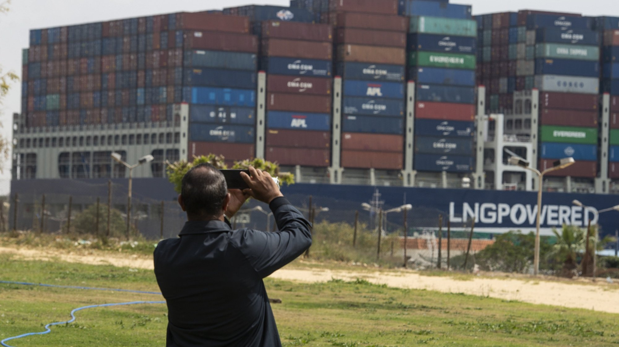 epa09106426 A container ship starts moving in the Suez Canal, in Ismalia, Egypt, 30 March 2021. The Suez Canal Authority on 29 March said that traffic is to resume after the large container ship 'Ever Given' was refloated and 43 vessels had resumed transit so far from the Great Bitter Lake, which separates two sections of the canal. The Ever Given ran aground in the Suez Canal on 23 March, causing a huge traffic backlog of ships.  EPA/Mohamed Hossam