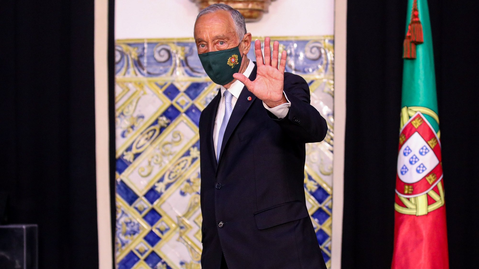 Portugal's President Marcelo Rebelo de Sousa waves after received from the Secretary General of the Presidency of the Republic (L) the Band of the Three Orders, symbol of the President of the Republic and Grand Master of the Portuguese Honorific Orders as he arrives to Belem Palace, after his swearing ceremony for a second term as President of the Republic, in Lisbon, Portugal, 09 March 2021. Reelected in the January 24 presidential elections with 60.67% of the votes cast, the 72-year-old retired law professor, a former constituent deputy, will be sworn in on the original of the Constitution of the Portuguese Republic. ANDRE KOSTERS/LUSA