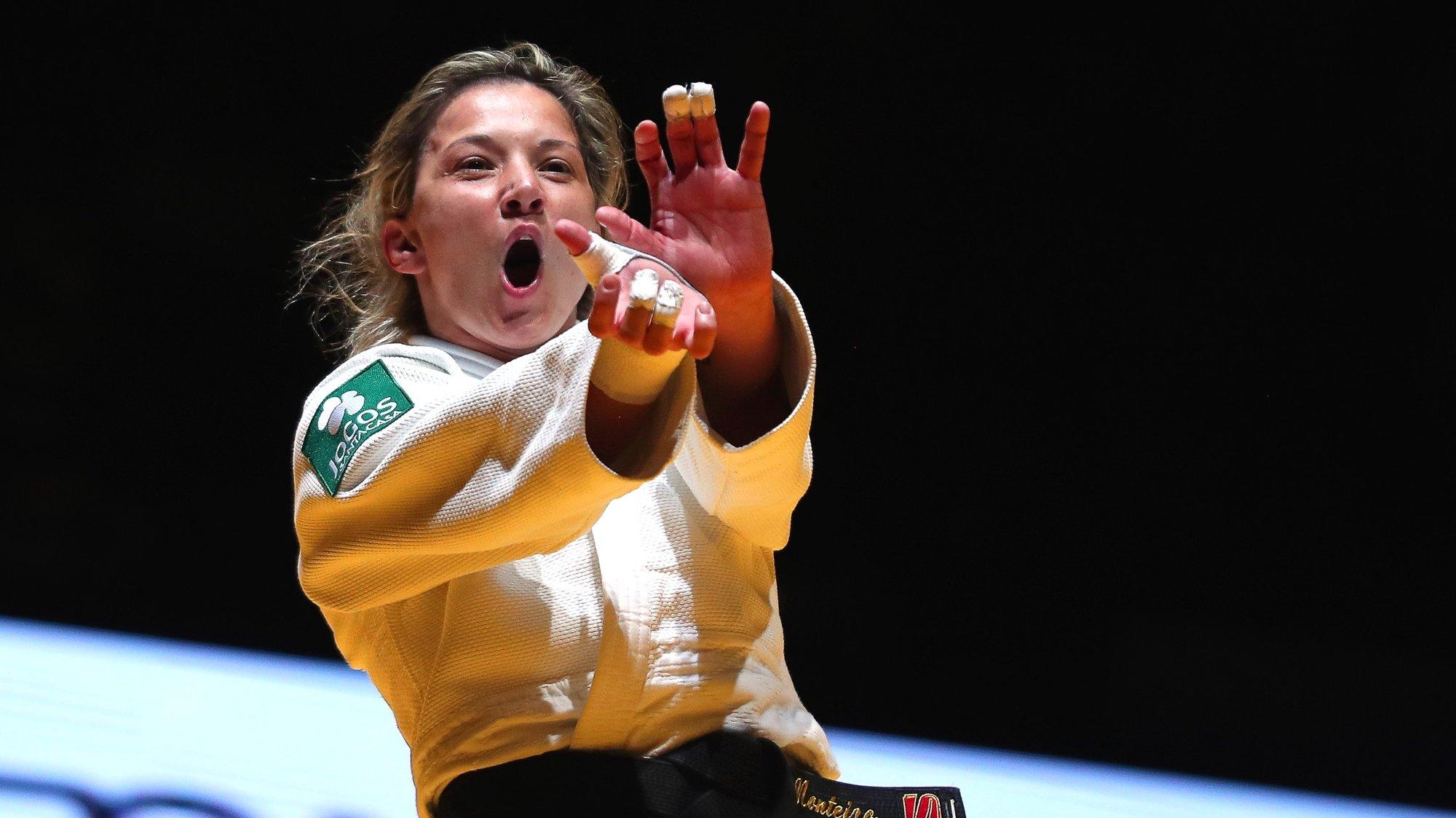 epa09140071 Telma Monteiro of Portugal celebrates after beating Kaja Kajzer of Slovenia in their gold medal bout of the women's -57kg category at the European Judo Championships in Lisbon, Portugal, 16 April 2021.  EPA/NUNO VEIGA
