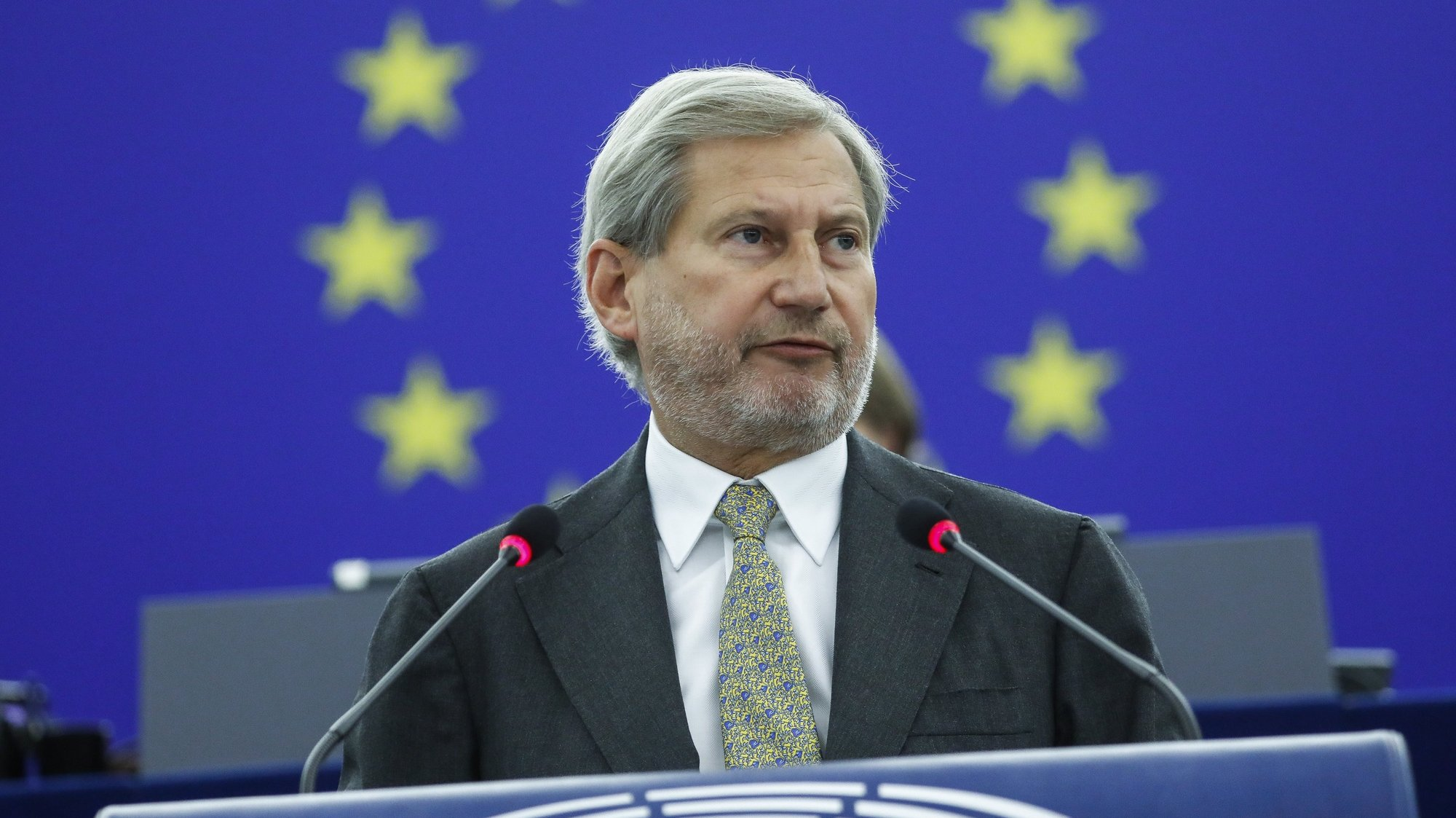 epa09257472 EU Budget Comissionner Johannes Hahn delivers a speech on Rule of Law situation in the European Union and the application of the conditionality regulation 2020/2092, during a plenary session at the European Parliament in Strasbourg, France, 09 June 2021.  EPA/JULIEN WARNAND