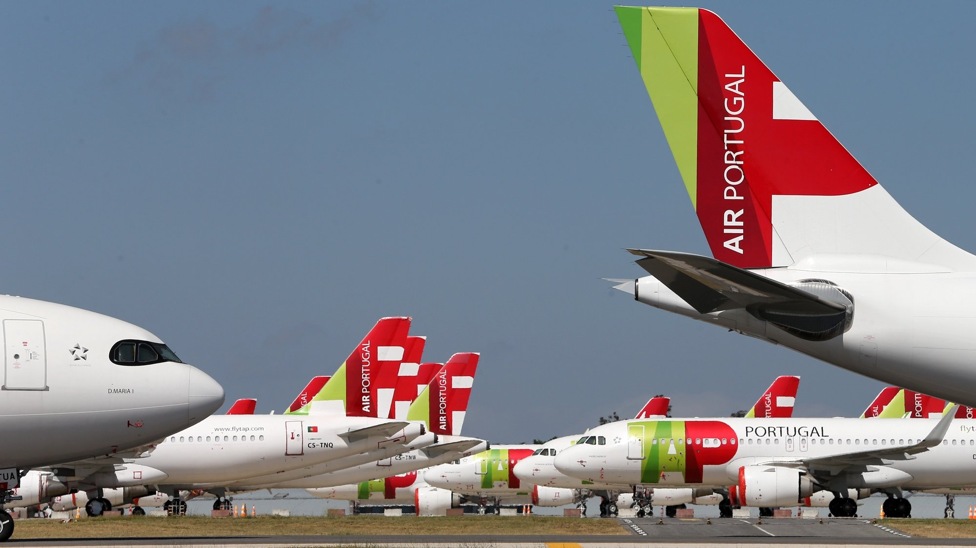 epa08524023 A TAP Air Portugal aircraft grounded at Humberto Delgado airport closed for passenger traffic as part of the exceptional traffic measures to combat the epidemiological situation of Covid-19, in Lisbon, Portugal, 09 April 2020 (reissued 02 July 2020). The granting of state support to TAP has been under discussion since the airline's activity came to a standstill because of the coronavirus pandemic, with an agreed injection of up to 1,200 million euros.  EPA/MANUEL DE ALMEIDA