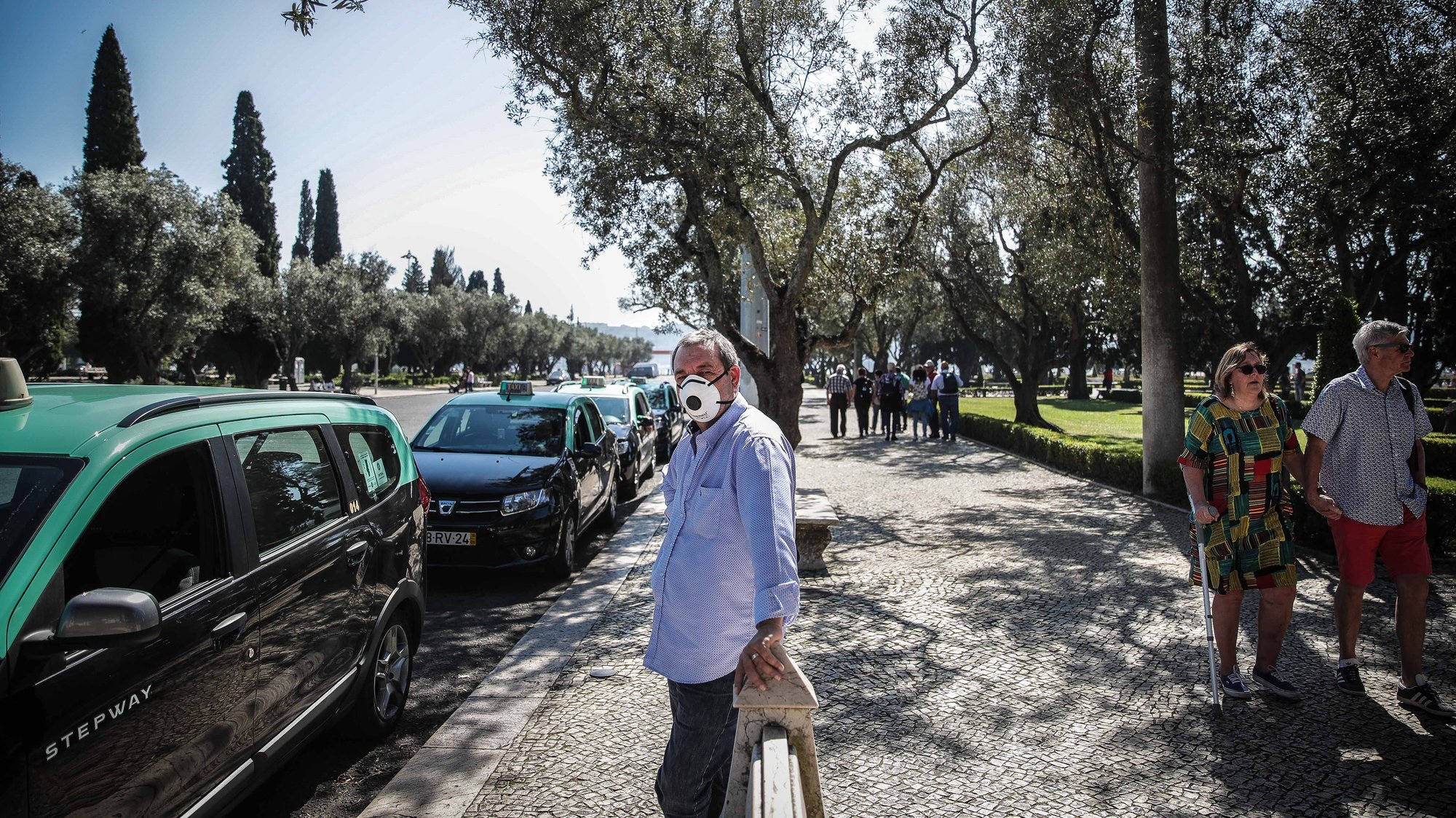 A taxi driver wears a protective mask as he waits outside Jeronimos Monestary which was closed due to the ongoing pandemic of the COVID-19, Lisbon, Portugal, 14 March 2020. The number of COVID-19 infections throughout Portugal has risen to 169. MÁRIO CRUZ/LUSA