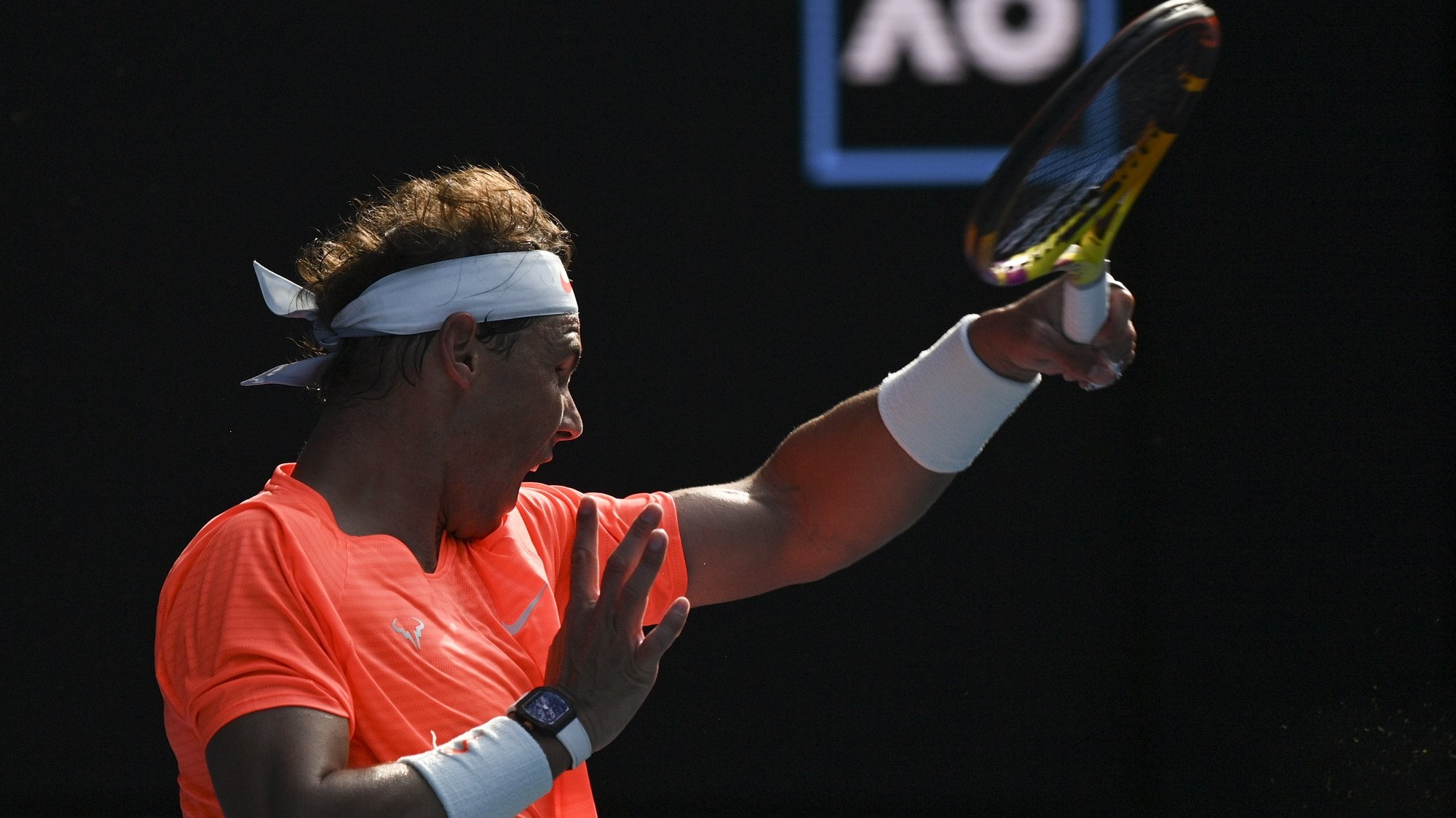 epa09013589 Rafael Nadal of Spain in action during his fourth Round Men's singles match against Fabio Fognini of Italy on Day 8 of the Australian Open Grand Slam tennis tournament in Melbourne, Australia, 15 February 2021.  EPA/DEAN LEWINS