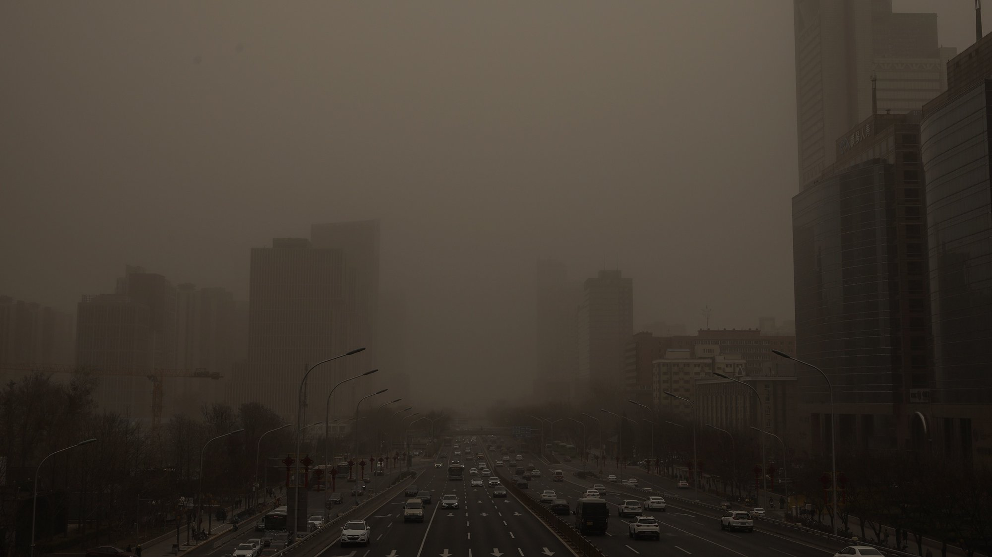 epa09075484 A view shows the skyline affected by a sandstorm, in Beijing, China, 15 March 2021. According to the National Meteorological Center, floating sand and dust are expected to sweep of China's Xinjiang, Inner Mongolia, Heilongjiang, Jilin, Liaoning, Gansu, Ningxia, Shaanxi, Shanxi, Hebei, Beijing and Tianjin.  EPA/WU HONG