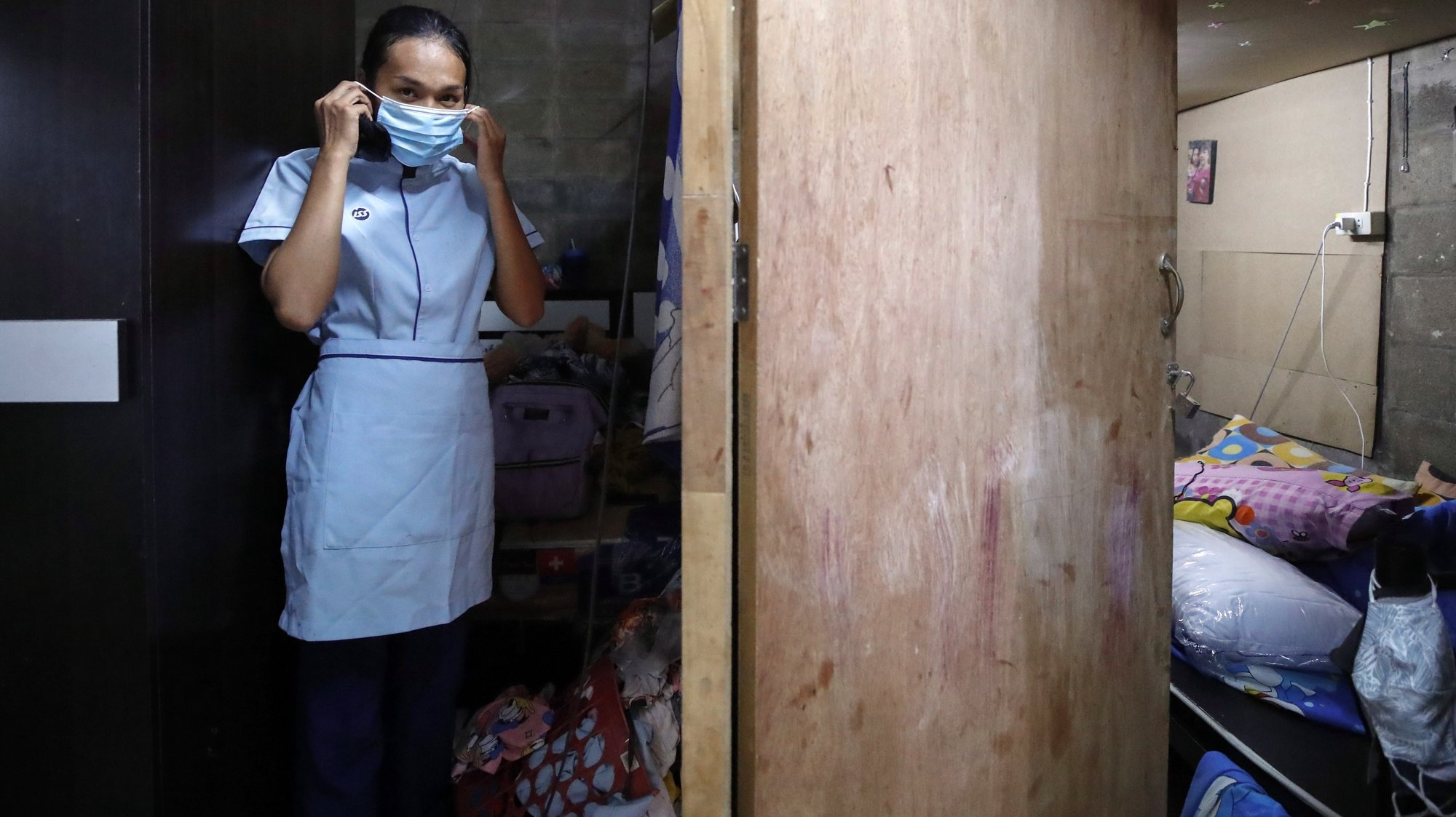 epa08495230 Wannisa Manatham puts on her protective mask at her home before leaving for work in Bangkok, Thailand, 23 May 2020 (issued 19 June 2020). In a neighborhood affected by crime and drug addiction, Wannisa faces economic drowning by Covid-19. Along with her uncle, Wannisa, who works as a cleaner in a hospital earning about 12,000 baht a month (about 376 dollars), is the only adult out of four in her family who have not lost their job to the pandemic. (about 376 US dollars). The pandemic has killed more men but it is women who are the most vulnerable to its socio-economic effects. Women often have to care for children, elderly and sick during lockdown. Many have not only lost their jobs but have been exposed to domestic violence as well as a widening in the gap of systematic inequality, especially in the poorest countries. UN Women warns in a report on the effects of Covid-19 that women do an average of 4.1 hours a day unpaid work such as housework or caring for dependents, three times as much as men. All the unpaid care carried out by women is equivalent to 2.35 percent of the global GDP or 1.35 trillion US dollars. In addition to occupying 70 percent of jobs in the health sector worldwide, women generally earn an average of 16 percent less than men, which rises to 35 percent in some countries.  EPA/DIEGO AZUBEL To go with EFE story by Gaspar Ruiz ATTENTION: This Image is part of a PHOTO SET