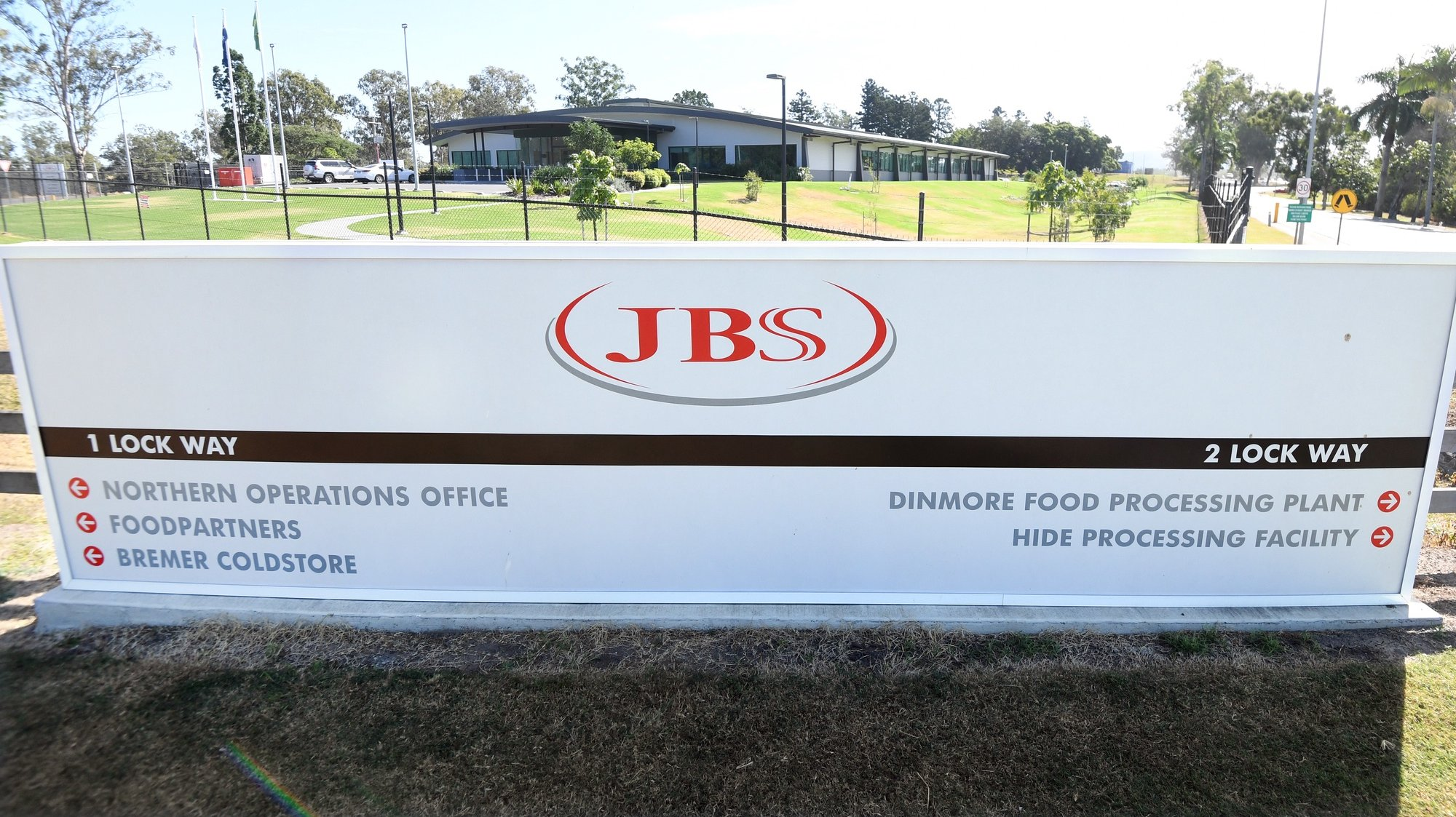 epa09242212 (FILE) The entrance to the JBS Australia's Dinmore meatworks facility, west of Brisbane, Australia, 12 May 2020 (re-issued 02 June 2021). Computer networks at JBS were hacked causing operations in Australia, Canada and the US to temporarily shut down. The ransomware attack originated from a criminal group likely based in Russia, the White House said.  EPA/DAN PELED AUSTRALIA AND NEW ZEALAND OUT *** Local Caption *** 56079708