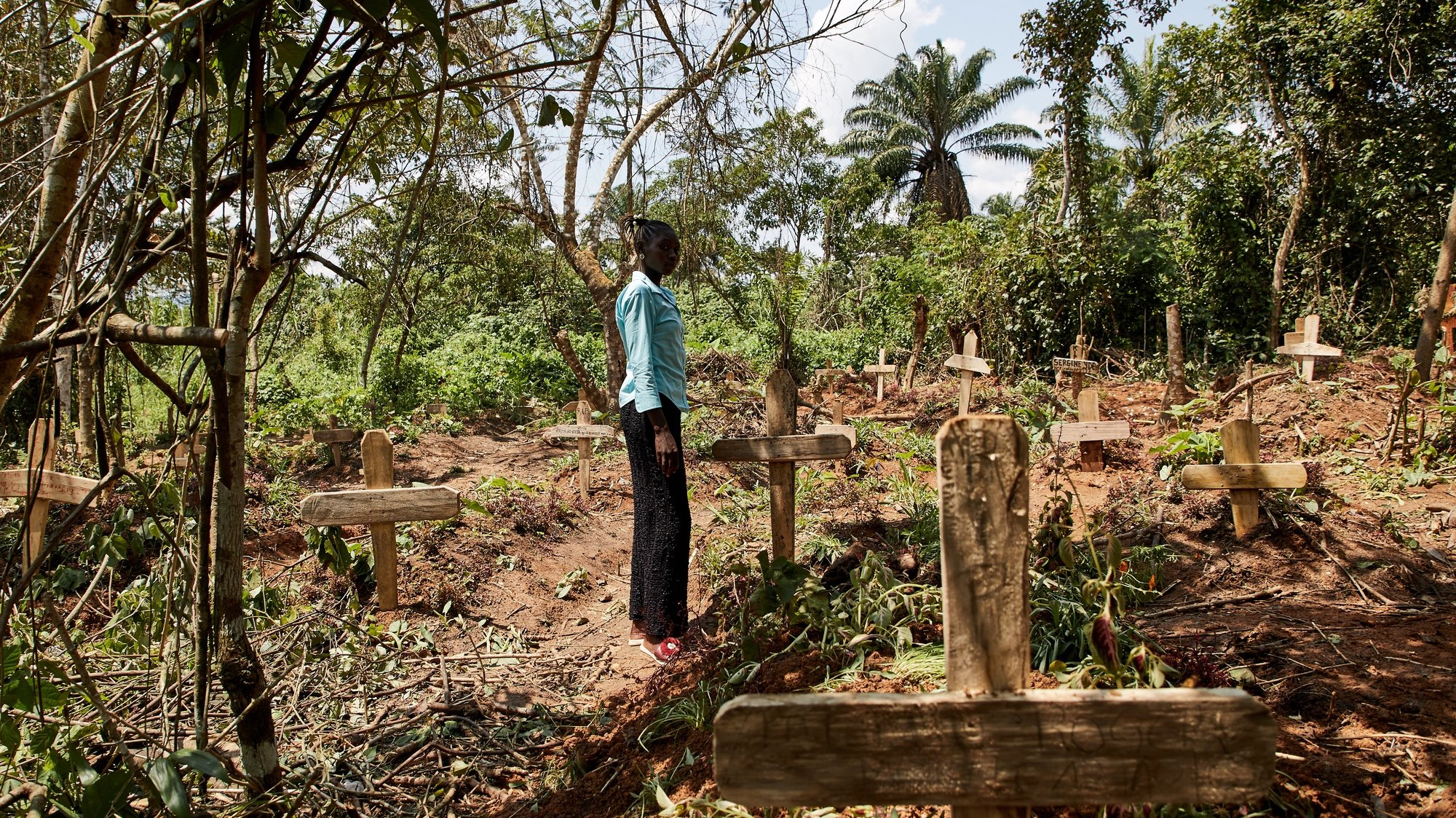 epaselect epa08891328 (19/39) Yvette Adaniya, an Ebola survivor, visits and pays her respects to the grave of her husband at a specially designated site for burials of Ebola victims, to the North of Beni, North Kivu, Democratic Republic of Congo, 14 October 2020. 'The devil will not distract us again,' says Adaniya, who lost her husband to the virus as this unfamiliar disease broke out in the forests to the North of Beni, North Kivu. 'When I had Ebola, my whole body and soul were affected. I lost weight and became bruised and black. I was throwing up, with diarrhea and headaches.  I feel like I am recovered, but I don't have any strength like before. My body became weak, not like it used to be.  In my family, it killed 2 people, my husband, and my brother-in-law.  When it arrived in the village, we got infected at the health center, my husband was ill [with another sickness] so we took him to the health center nearest the village. We shared the same room with a person affected by Ebola, who was about to be collected by an ambulance.  We weren't sure what it was, yes they would tell us it was Ebola, but this disease was like a demon, we did not listen to the information, we thought it was about politics, not a disease. We did not rush to the health center; rumors spread that people don't leave the health center: that [our ethnic group] Nande, would never leave there.  Advice for people suffering with this Corona, Covid-19. We need to be flexible, washing hands, use hygiene. The devil will not distract us again, we were like fools, and we did not listen. This time we need to be flexible to follow and respect what  doctors say.'  EPA/Hugh Kinsella Cunningham ATTENTION EDITORS / MANDATORY CREDIT : This story was produced in partnership with the Pulitzer Center -- For the full PHOTO ESSAY text please see Advisory Notice epa...