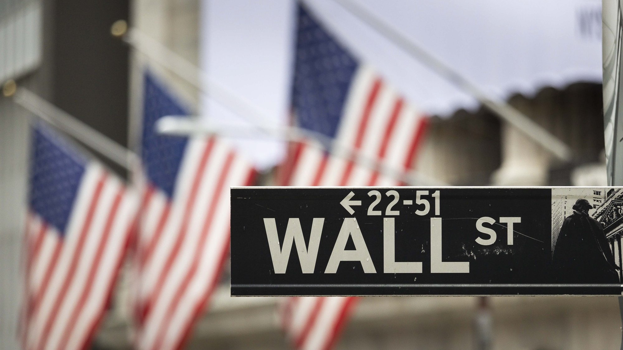 epa08839491 (FILE) - A sign for Wall Street outside of the New York Stock Exchange in New York, New York, USA, 28 October 2020 (reissued 24 November 2020). For the first time in its history, the US stock market index Dow Jones has risen above 30,000 points.  EPA/JUSTIN LANE