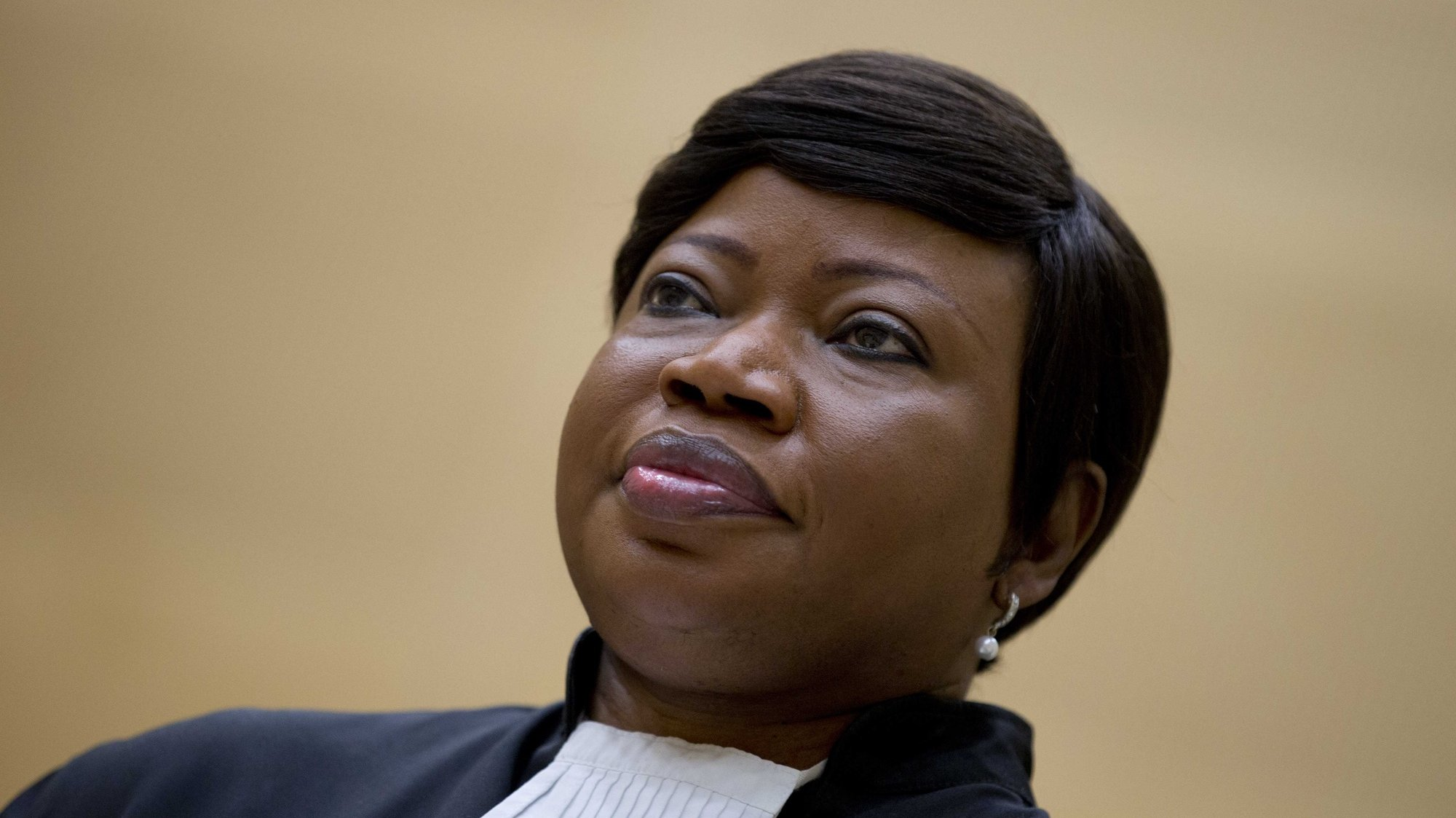 epa07486346 (FILE) -  Prosecutor Fatou Bensouda waits for former Congo Vice President Jean-Pierre Bemba to enter the court room of the International Criminal Court (ICC) to stand trial with Aime Kilolo Musamba, Jean-Jacques Mangenda Kabongo, Fidele Babala Wandu and Narcisse Arido, in The Hague, Netherlands, 29 September 2015, reissued 05 April 2019. Media reports on 05 April 2019 state that the US has revoked the visa of Fatou Bensouda, the international criminal court's chief prosecutor, her office has said, over a possible investigation into US soldiers actions in Afghanistan.  EPA/PETER DEJONG / POOL *** Local Caption *** 52273662
