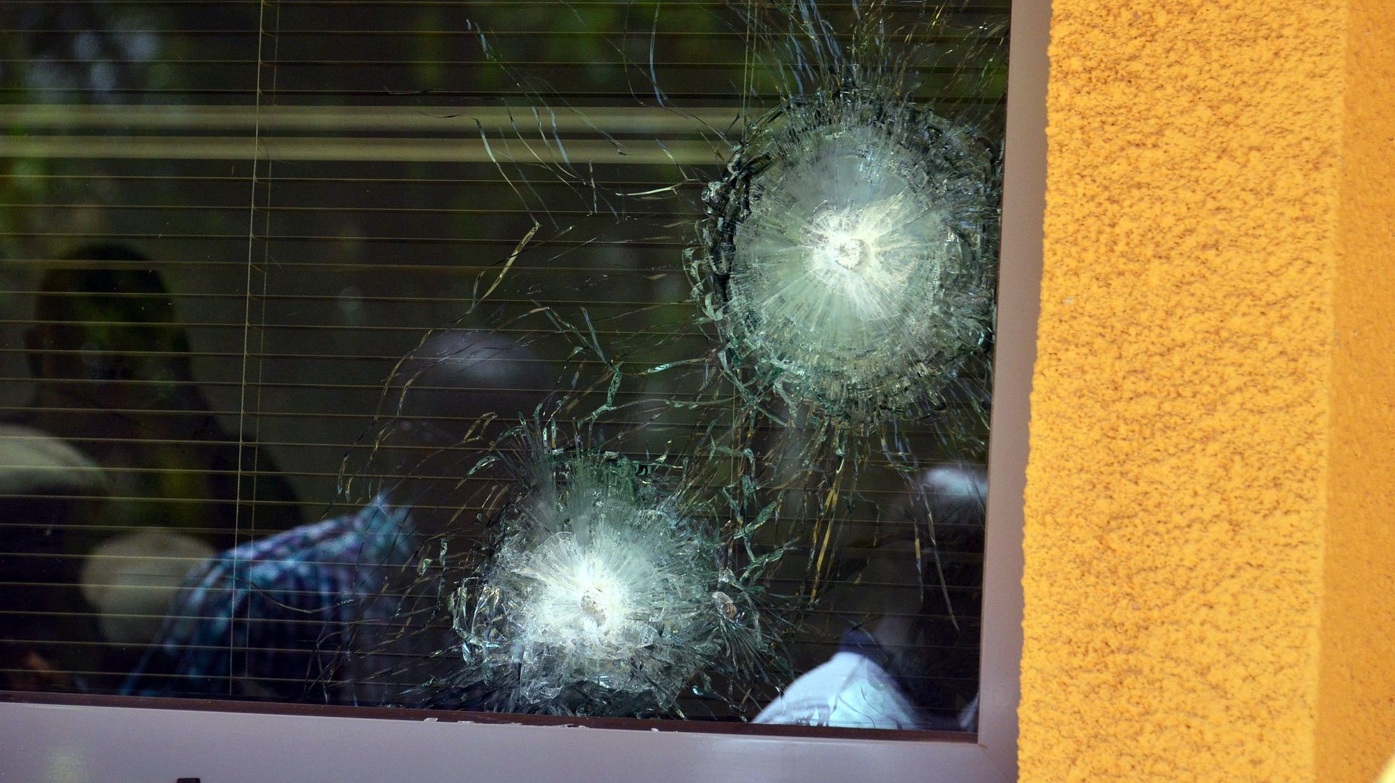 epa06577579 A bullet-shattered window at the French Embassy after an alleged terrorist attacks in the capital Ouagadougou, Burkina Faso, 03 March 2018. According to reports at least 28 people have been killed and dozens left wounded in the attacks on the French Embassy and miltary headquarters in Ouagadougou.  EPA/LEGNAN KOULA