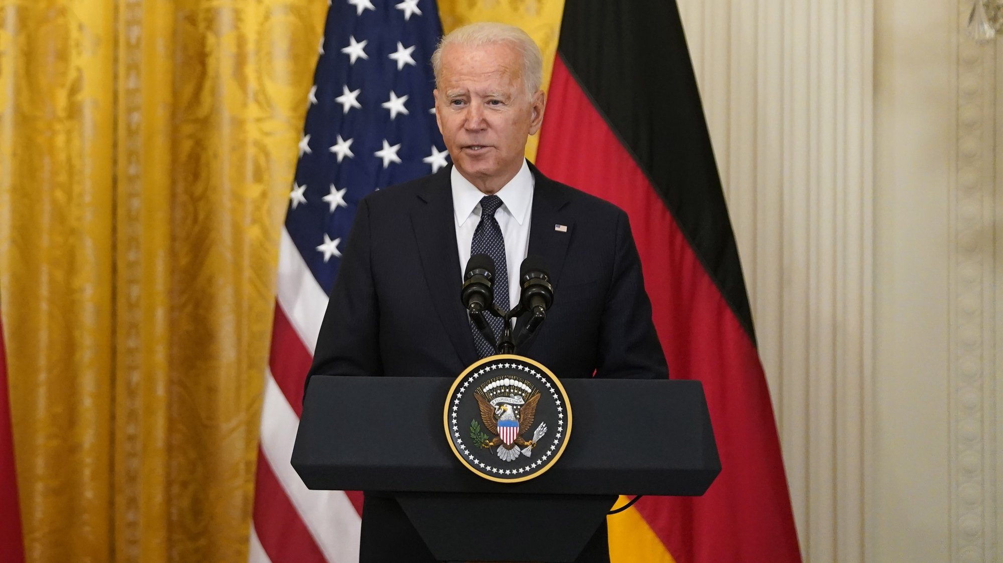 epa09347372 US President Joe Biden and German Chancellor Angela Merkel (Not Seen) participate in a joint press conference in the East Room of the White House in Washington, DC, USA, 15 July 2021. The two leaders met earlier to discuss the Russian Nord Stream 2 pipeline, climate change, Covid-19 vaccines, and Russian cyber attacks.  EPA/Alex Edelman / POOL