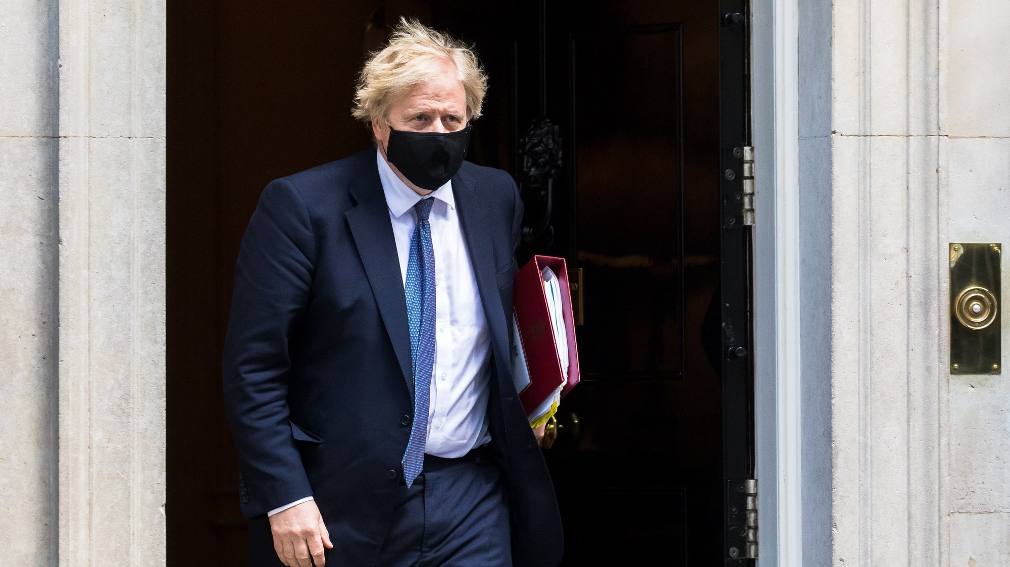 epa09211359 British Prime Minister Boris Johnson departs 10 Downing Street for Prime Minister Questions at parliament in London, Britain, 19 May 2021. Johnson faces the MPs' weekly question time in the House of Commons.  EPA/VICKIE FLORES