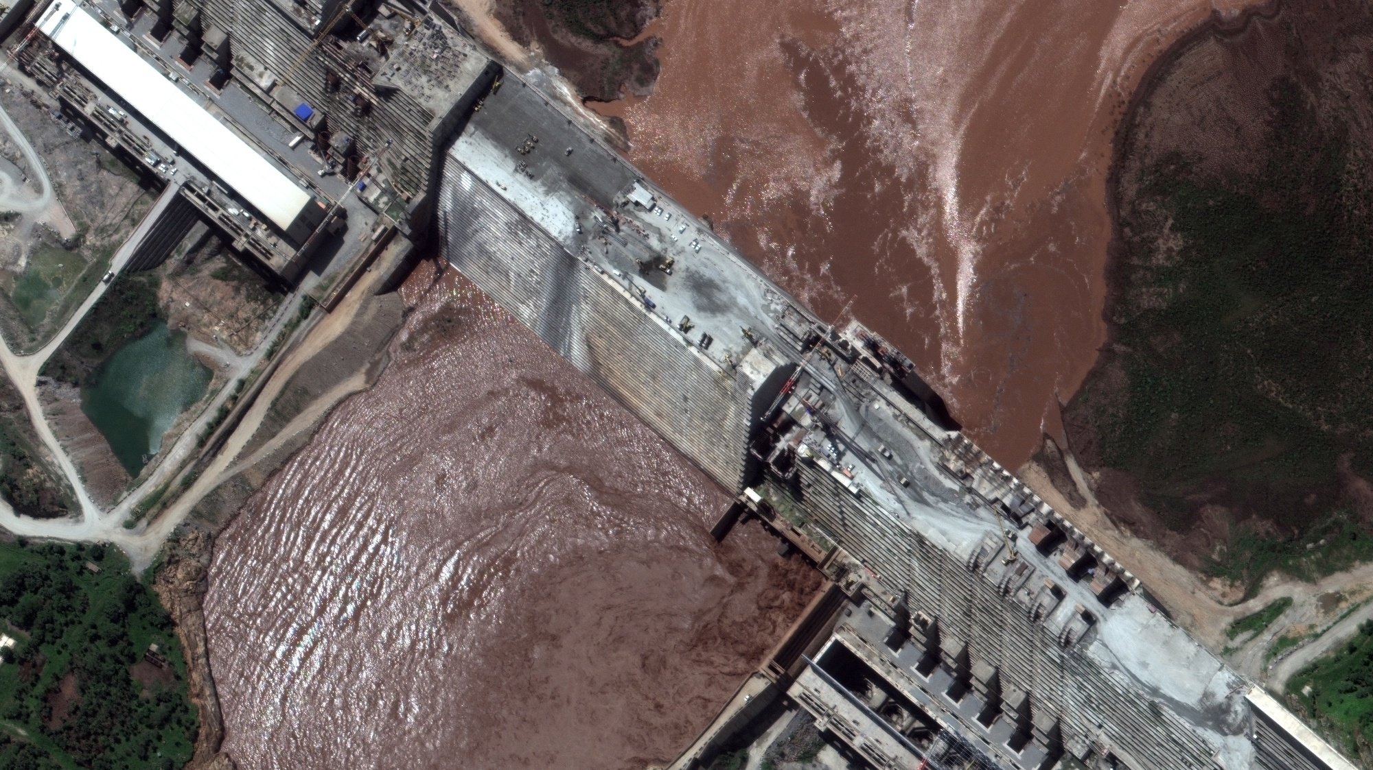 epa08548879 A satellite image made available by MAXAR Technologies shows a close-up view of the Grand Ethiopian Renaissance Dam (GERD) and the Blue Nile River, in the Benishangul-Gumuz region of Ethiopia, 26 June 2020 (issued 16 July 2020). The GERD dam on the Blue Nile River in Ethiopia has been under construction since 2011. The project affects Sudan and Egypt as the Blue Nile river flows north from the dam and is of vital importance to the Nile River. Recent satellite imagery revealed a large reservoir that started to fill behind the dam.  EPA/MAXAR TECHNOLOGIES HANDOUT -- MANDATORY CREDIT: SATELLITE IMAGE 2020 MAXAR TECHNOLOGIES -- the watermark may not be removed/cropped -- HANDOUT EDITORIAL USE ONLY/NO SALES
