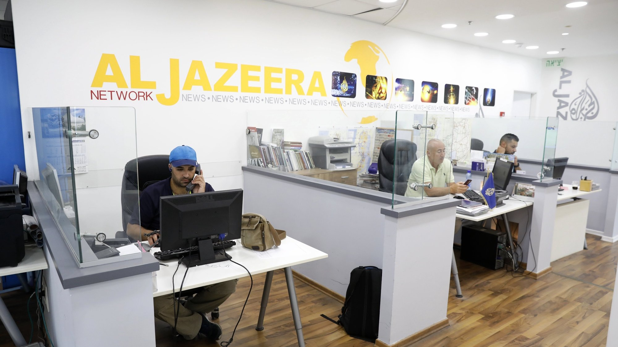 epa06130163 Employees of Al Jazeera satellite channel work at their Jerusalem bureau, in Israel, 07 August 2017. Al Jazeera on 06 August 2017 reported that Israel's communication minister Ayoub Kara at a press conference had said he had made a request to cancel the credentials of Al Jazeera journalists and shut down the its offices in Jerusalem. Israeli media reported 14 June 2017 that Israeli Prime Minister Benjamin Netanyahu then had decided to consider the closure of the station's offices.  EPA/ABIR SULTAN