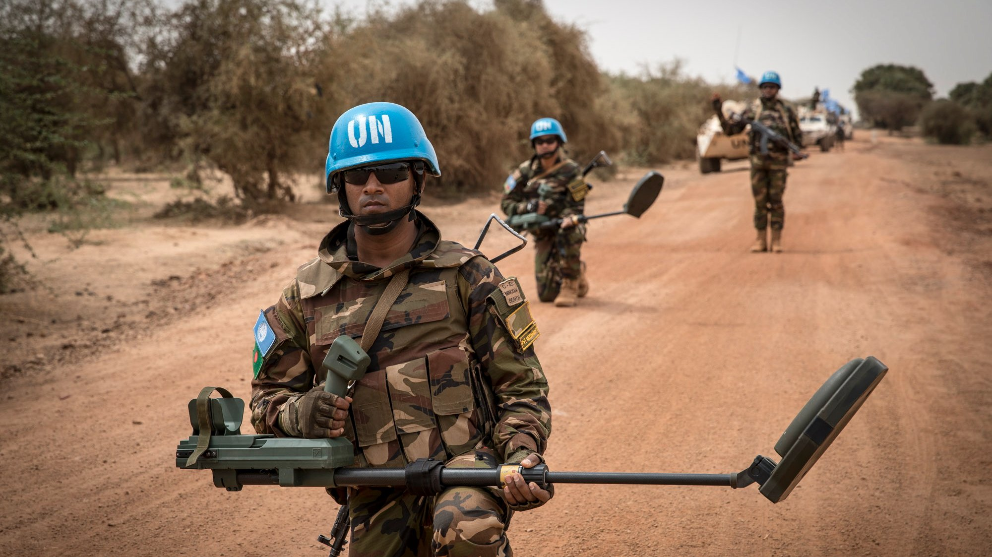 epa07519672 A handout photo made available by MINUSMA, a United Nations peacekeeping force in Mali, showing UN peacekeeping soldiers with mine-detecting devices walking ahead of a convoy with armoured vehicles on patrol at a undisclosed location in Mali, 27 March 2019. Reports on 21 April 2019 state one UN peacekeeper was killed and four others wounded in an attack 20 April against MINUSMA forces in Mali's Mopti region. MINUSMA said in a statement that a UN convoy was attacked by using an improvised explosive device, also called IED. UN confirmed those dead and injured were from Egypt. One attacker was reportedly killed while eight others were taken prisoners.  EPA/MINUSMA HANDOUT  HANDOUT EDITORIAL USE ONLY/NO SALES