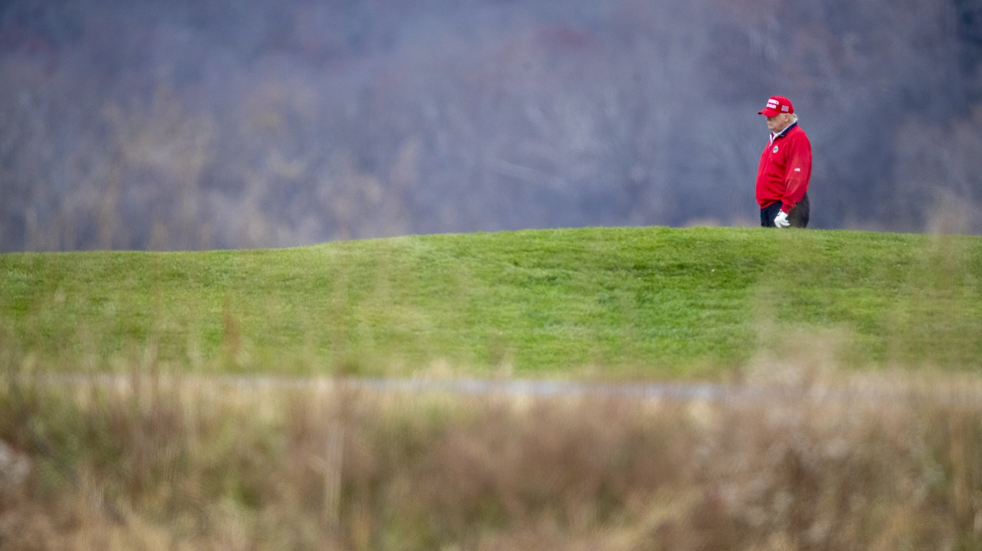 epa08847130 US President Donald J. Trump golfs at his Trump National Golf Club in Sterling, Virginia, USA, 27 November 2020. Following his round of golf President Trump boarded Marine One on the course and lifted off for Camp David where he will join his family for the weekend.  EPA/SHAWN THEW