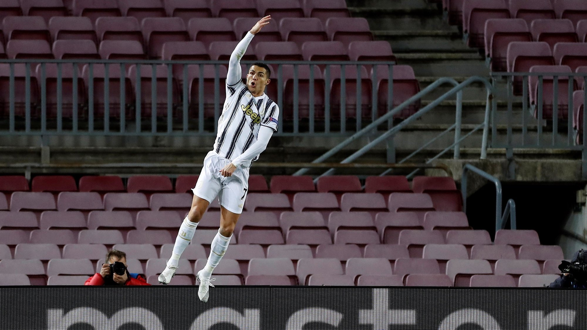 epa08871496 Juventus' striker Cristiano Ronaldo celebrates after scoring the 0-3 from the penalty during the UEFA Champions League group G between FC Barcelona and Juventus at Camp Nou stadium in Barcelona, Catalonia, Spain, 08 December 2020.  EPA/Alberto Estevez