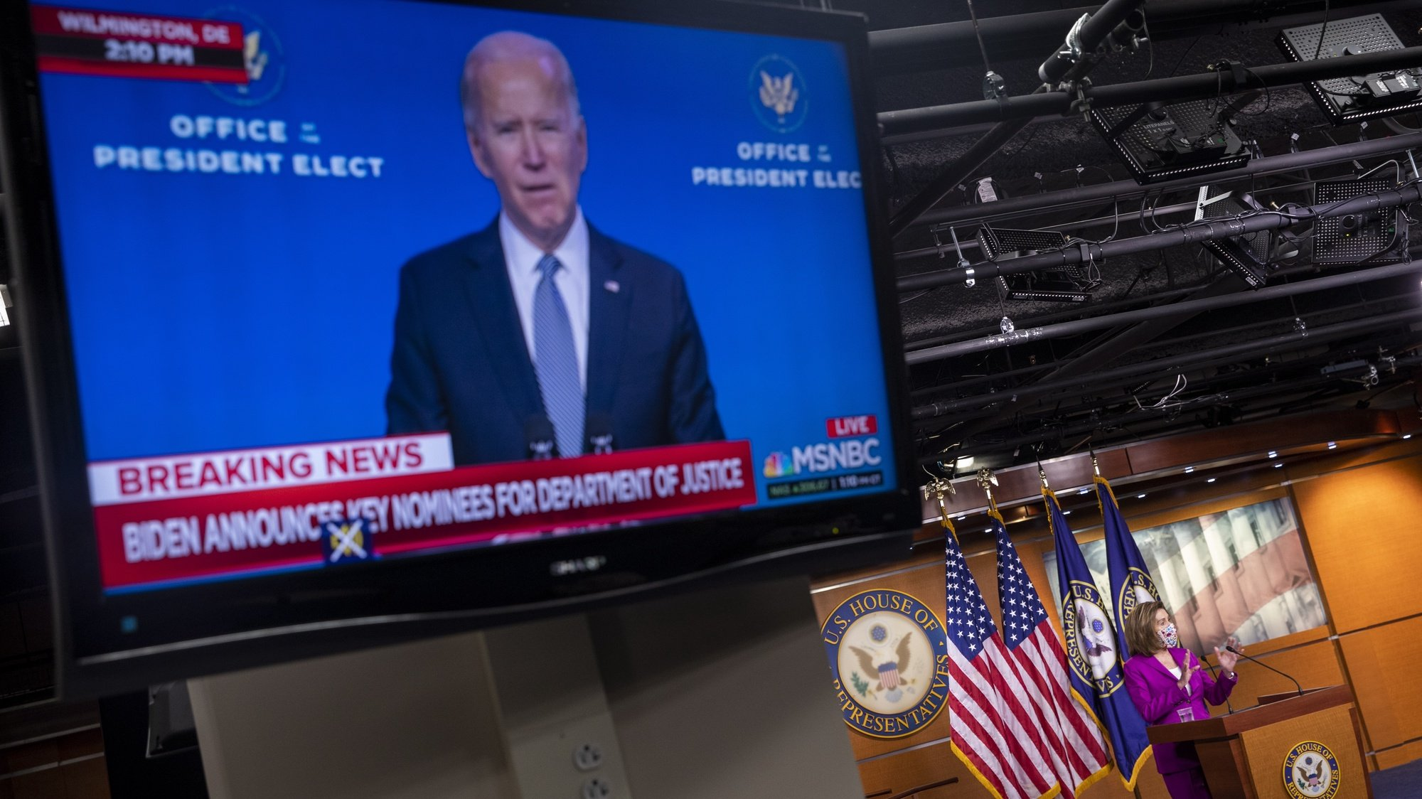 epa08925263 Vice President Elect Joe Biden is seen on television as Speaker of the House Nancy Pelosi delivers remarks during a press conference inside the US Capitol in Washington, DC, USA, 07 January 2021. Speaker Pelosi called for the removal of US President Donald J. Trump either by the cabinet invoking the 25th amendment or possibly through the House taking up articles of impeachment.  EPA/SHAWN THEW