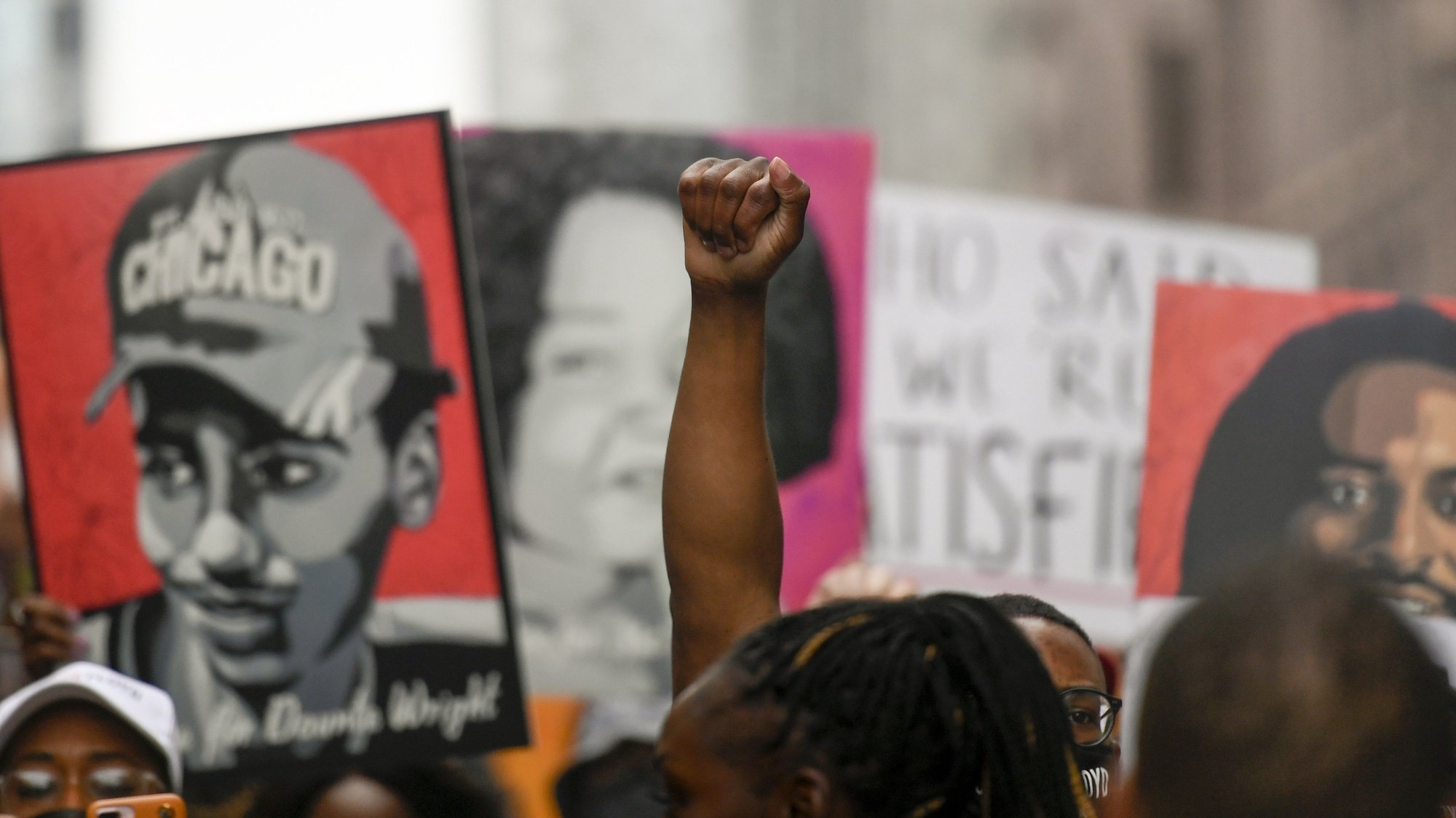 epa09224577 Hundreds of protesters march through the streets to commemorate the anniversary of George Floyd's death in Minneapolis, Minnesota, USA, 23 May 2021. The rally and march is part of several days of events to mark the one year anniversary of Floyd's death that sparked the Black Lives Matter movement around the world.  EPA/CRAIG LASSIG