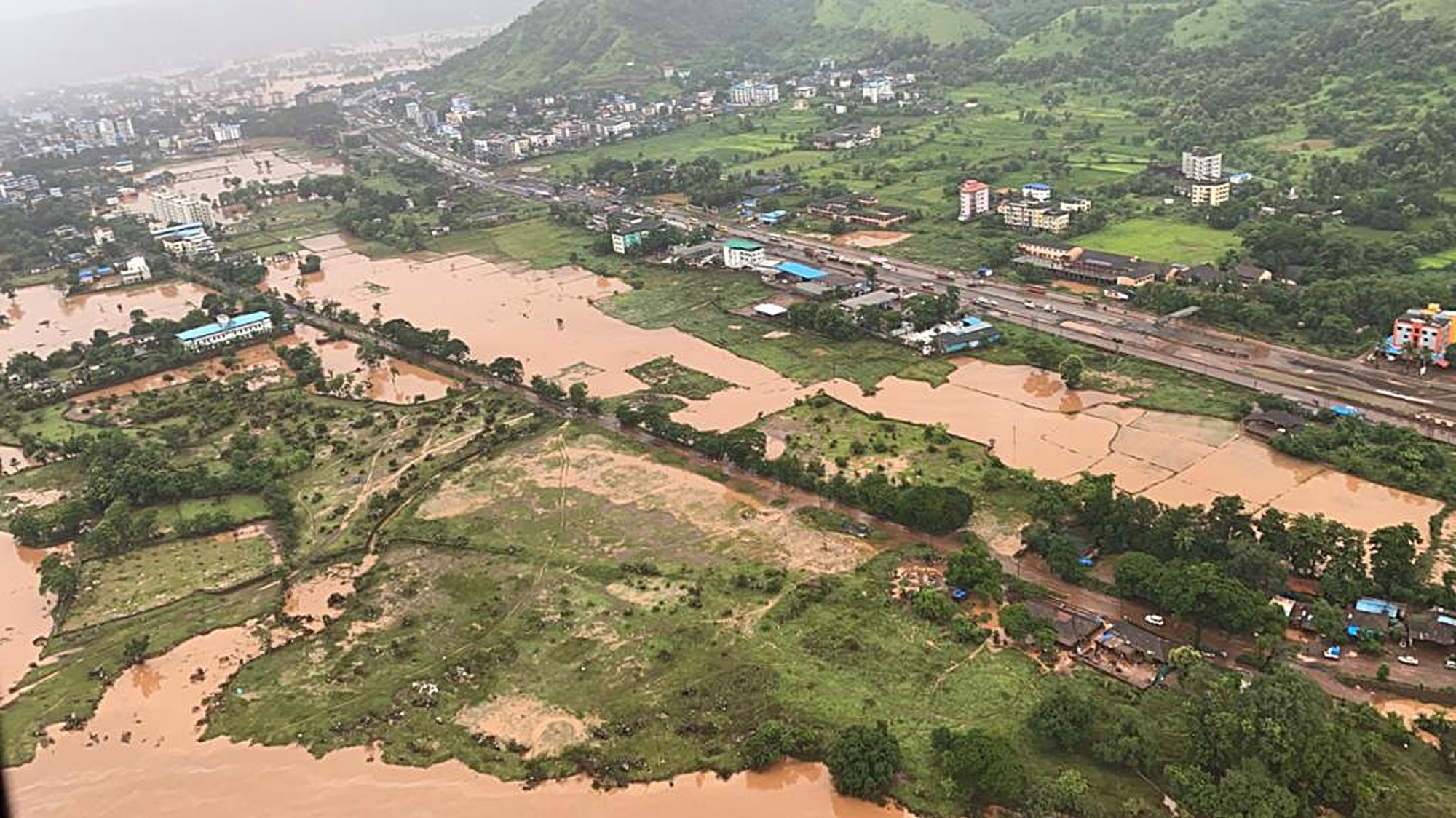epa09359493 A handout photo made available by the Indian Navy while doing the helicopter sortie on 23 July 2021 shows an aerial view of the Raigad district, Maharashtra, India, 23 July 2021.  According to the district administration severe rainfall in Maharashtra killed at least 36 people and another 30 are feared trapped in three landslides in various areas.  EPA/INDIAN NAVY HANDOUT  HANDOUT EDITORIAL USE ONLY/NO SALES