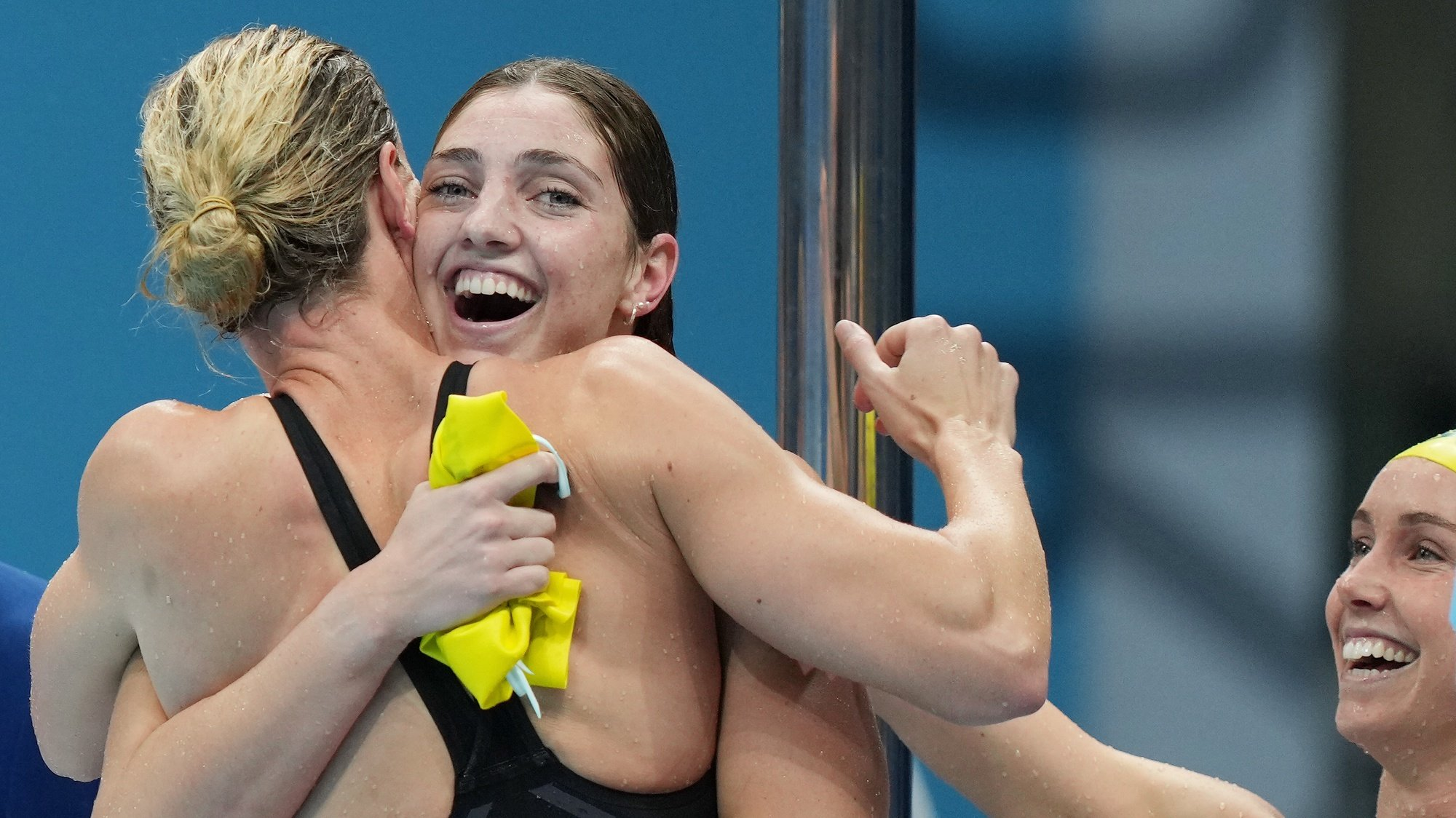 epa09363053 Australia's 4 x 100m Women's freestyle team of Cate Campbell, Emma McKeon, Meg Harris and Bronte Campbell celebrate after winning the Gold Medal with a world record swim in the Women's 4 x 100m Freestyle Relay final during the Tokyo Olympic Games at the Tokyo Aquatic Centre in Tokyo, Japan, 25 July 2021.  EPA/JOE GIDDENS NO ARCHIVING, EDITORIAL USE ONLY, IMAGES TO BE USED FOR NEWS REPORTING PURPOSES ONLY, NO COMMERCIAL USE WHATSOEVER, NO USE IN BOOKS WITHOUT PRIOR WRITTEN CONSENT FROM AAP AUSTRALIA AND NEW ZEALAND OUT