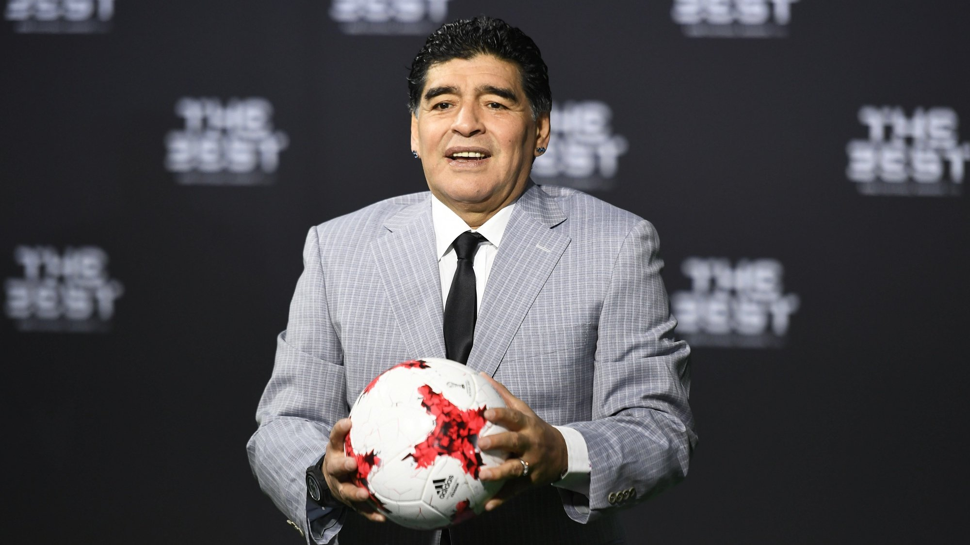 epa08841528 (FILE) - Argentinian soccer legend Diego Armando Maradona poses for photographers as he arrives prior to the FIFA Awards 2016 gala at the Swiss TV studio in Zurich, Switzerland, 09 January 2017 (re-issued on 25 November 2020). Diego Maradona has died after a heart attack, media reports claimed on 25 November 2020.  EPA/WALTER BIERI *** Local Caption *** 53218238