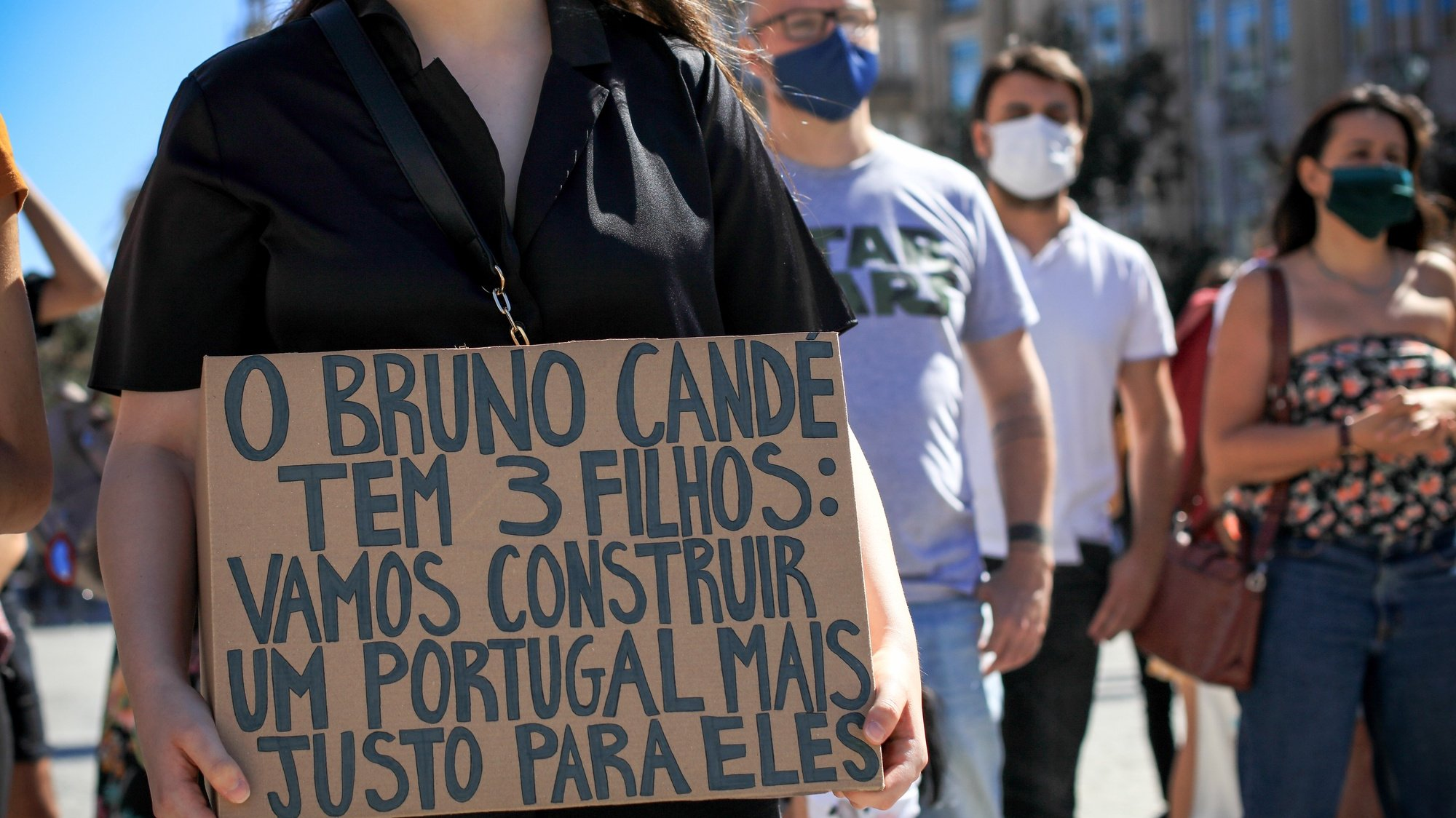 epa08579320 A demonstrator holds a banner with the words 'Bruno Cande has 3 children: let's build a fair Portugal for them' during a demonstration against the death of actor Bruno Cande and the victims of racism, Porto, Portugal, 01 August 2020. 39 years old actor Bruno Cande was shot dead last 25th July in Lisbon.  EPA/MANUEL FERNANDO ARAUJO