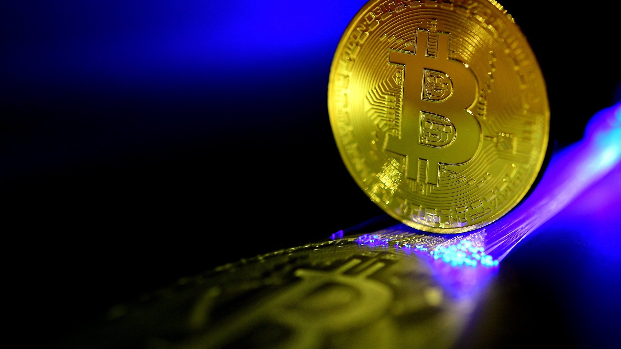 epa06407080 A Bitcoin is pictured in Duesseldorf, Germany, 27 December 2017. Wild swings in the price of bitcoin took a pause, after it temporarily dropped to 10,800 US dollar. The cryptocurrency's value plummeted by nearly a third last week, and was dealt another potential blow when the Israeli Securities Agency said it would bar companies trading in bitcoin from operating on the Tel Aviv stock exchange and investigate how to regulate the digital currency because of concerns about volatile prices.  EPA/SASCHA STEINBACH