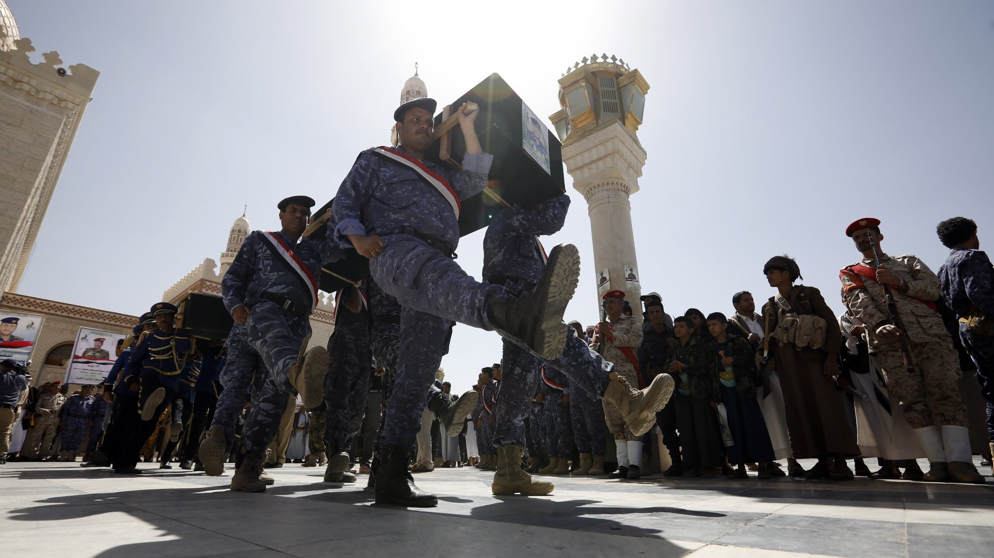 epa09091201 Pro-Houthi soldiers carry the coffins of slain Houthi fighters during a funeral procession a day after a Yemen peace initiative was offered by Saudi Arabia, in Sana'a, Yemen, 23 March 2021. Saudi Arabia has offered a peace initiative to the Houthis in Yemen, including a ceasefire and the reopening of Sana'a airport. A Saudi-led coalition has been fighting the Houthis since March 2015.  EPA/YAHYA ARHAB