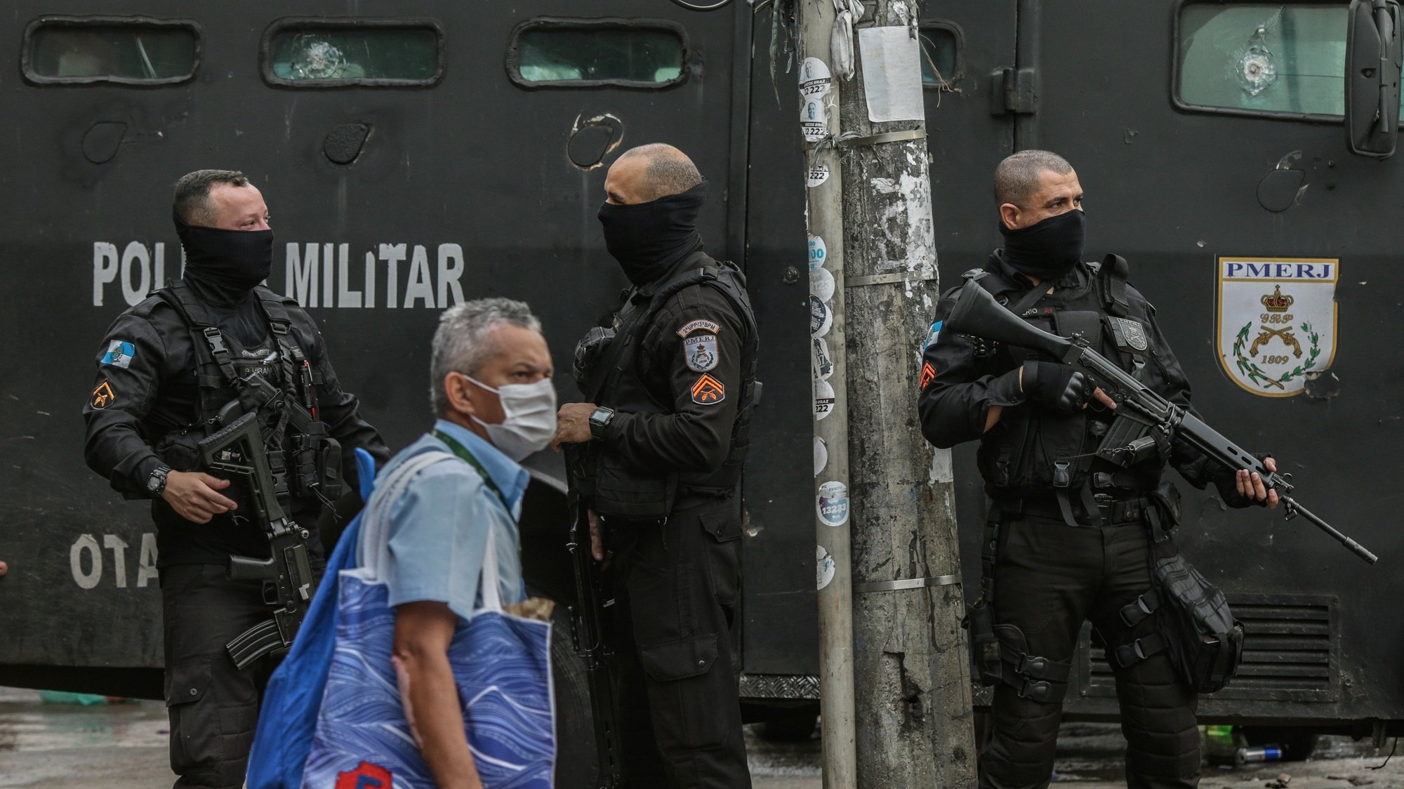 epa09183300 Military policemen stand on guard in Jacarezinho favela in Rio de Janeiro, Brazil, 07 May 2021, a day after 25 people died, including a police officer five more people were injured during a police operation against a gang of drug traffickers in the favela.  EPA/ANDRE COELHO