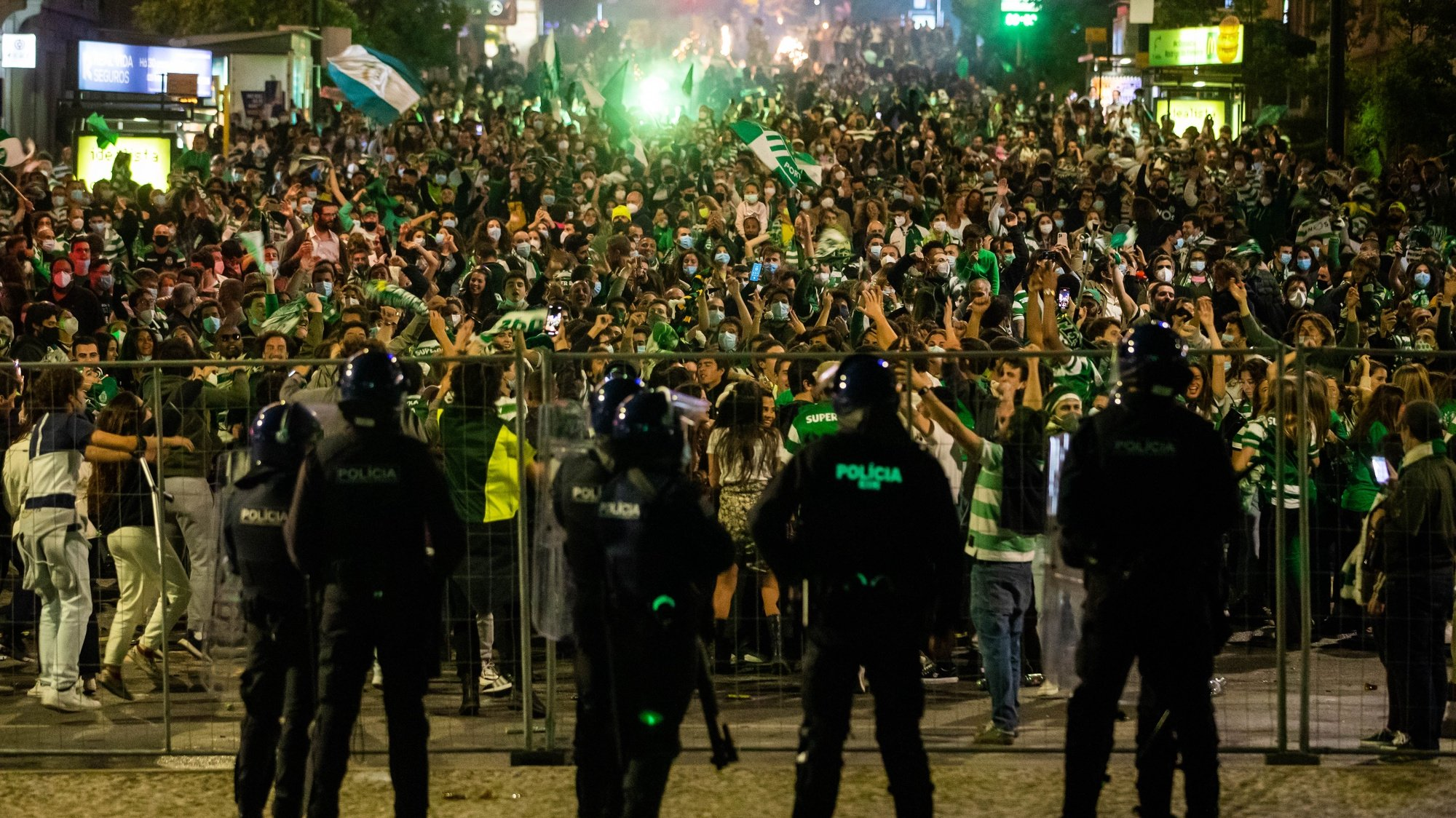 Police oficcers stand by as Sporting supporters are held behind fences as they celebrate the First League Soccer title at Marques do Pombal square, in Lisbon, Portugal, 11th May 2021. Sporting has been chasing this trophy since the 2001/02 season. JOSE SENA GOULAO/LUSA