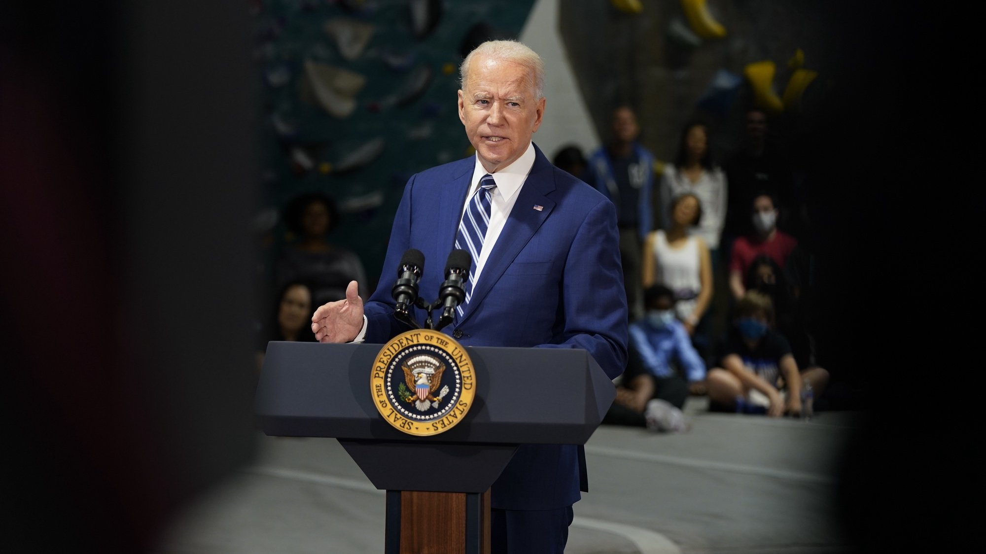 epa09233713 US President Joe Biden delivers remarks at Sportrock Climbing Center in Alexandria, Virginia, USA, 28 May 2021, to celebrate the significant progress Virginia has made in the fight against COVID-19, in partnership with the Biden-Harris Administration.  EPA/Chris Kleponis / POOL
