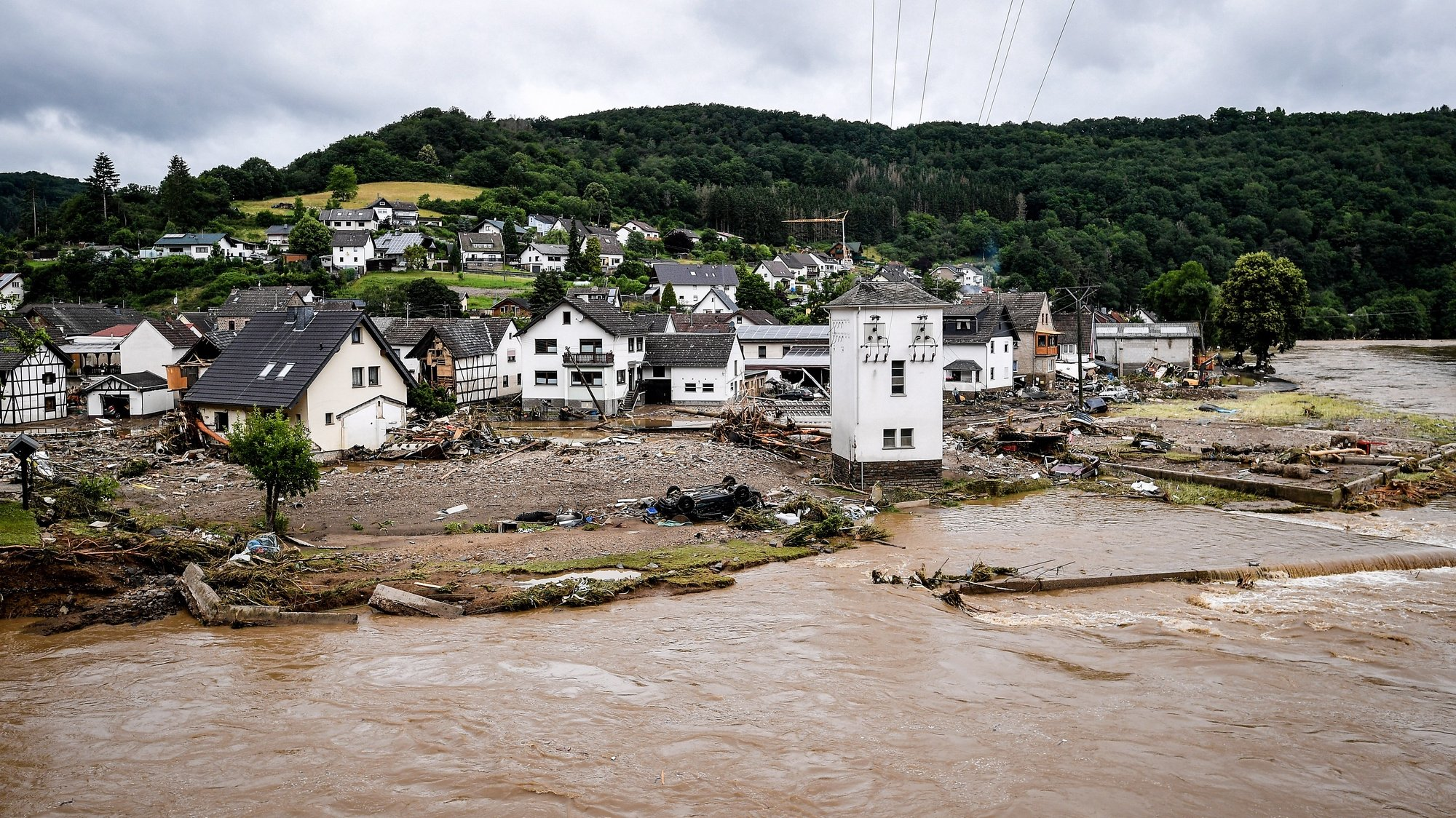 epa09345975 The village of Schuld in the district of Ahrweiler is destroyed after heavy flooding of the river Ahr, in Schuld, Germany, 15 July 2021. Large parts of Western Germany were hit by heavy, continuous rain in the night to Wednesday, resulting in local flash floods that destroyed buildings and swept away cars.  EPA/SASCHA STEINBACH