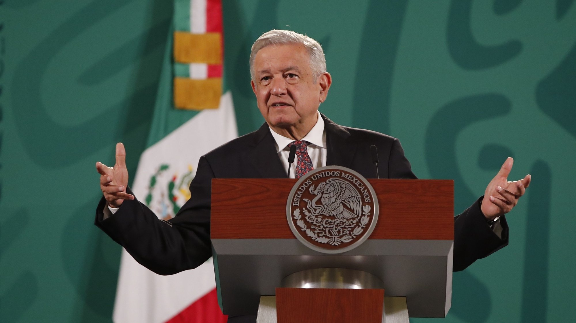 epa09342402 President of Mexico Andres Manuel Lopez Obrador speaks during a morning press conference, at the National Palace, in Mexico City, Mexico, 13 July 2021. Lopez Obrador reiterated that the Cuban economic bloc must be ended, and in the face of protests in recent days, he said he had no 'information' on possible interventionism by the United States.  EPA/JOSE MENDEZ