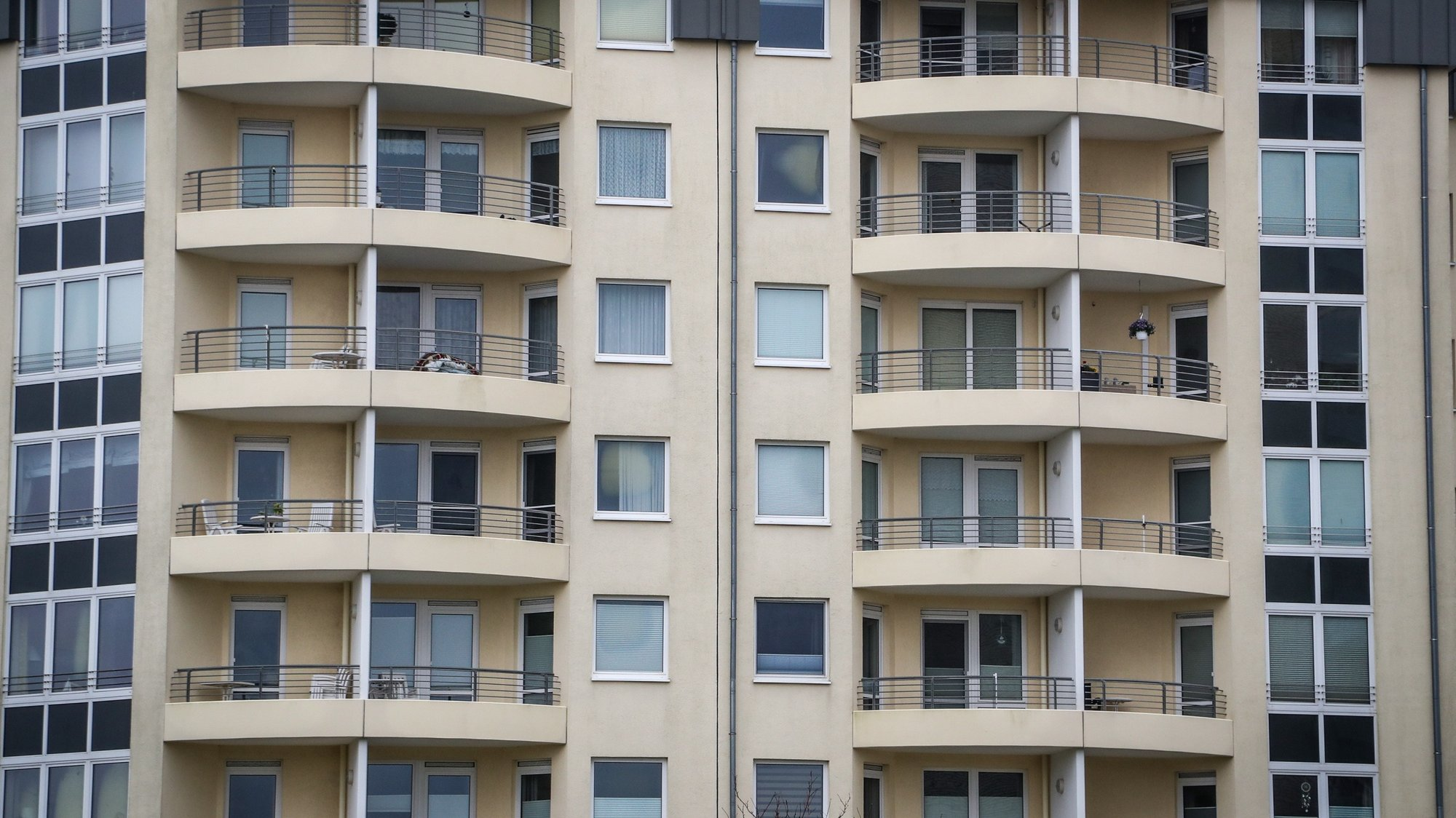 epa09115484 Balconies of an untenanted apartment building near the beach of Cuxhaven-Duhnen, northern Germany, 04 April 2021. Due to the rising numbers of COVID-19 cases caused by the SARS-CoV-2 coronavirus in Germany, most seaside resorts have imposed strict lockdown measures for the Easter weekend. Day trips to Cuxhaven and all overnight stays, even in own caravans, are prohibited, and restaurants may only sell take-away food. Only residents and owners of a secondary residence are allowed to take a walk on the beaches and promenades.  EPA/FOCKE STRANGMANN