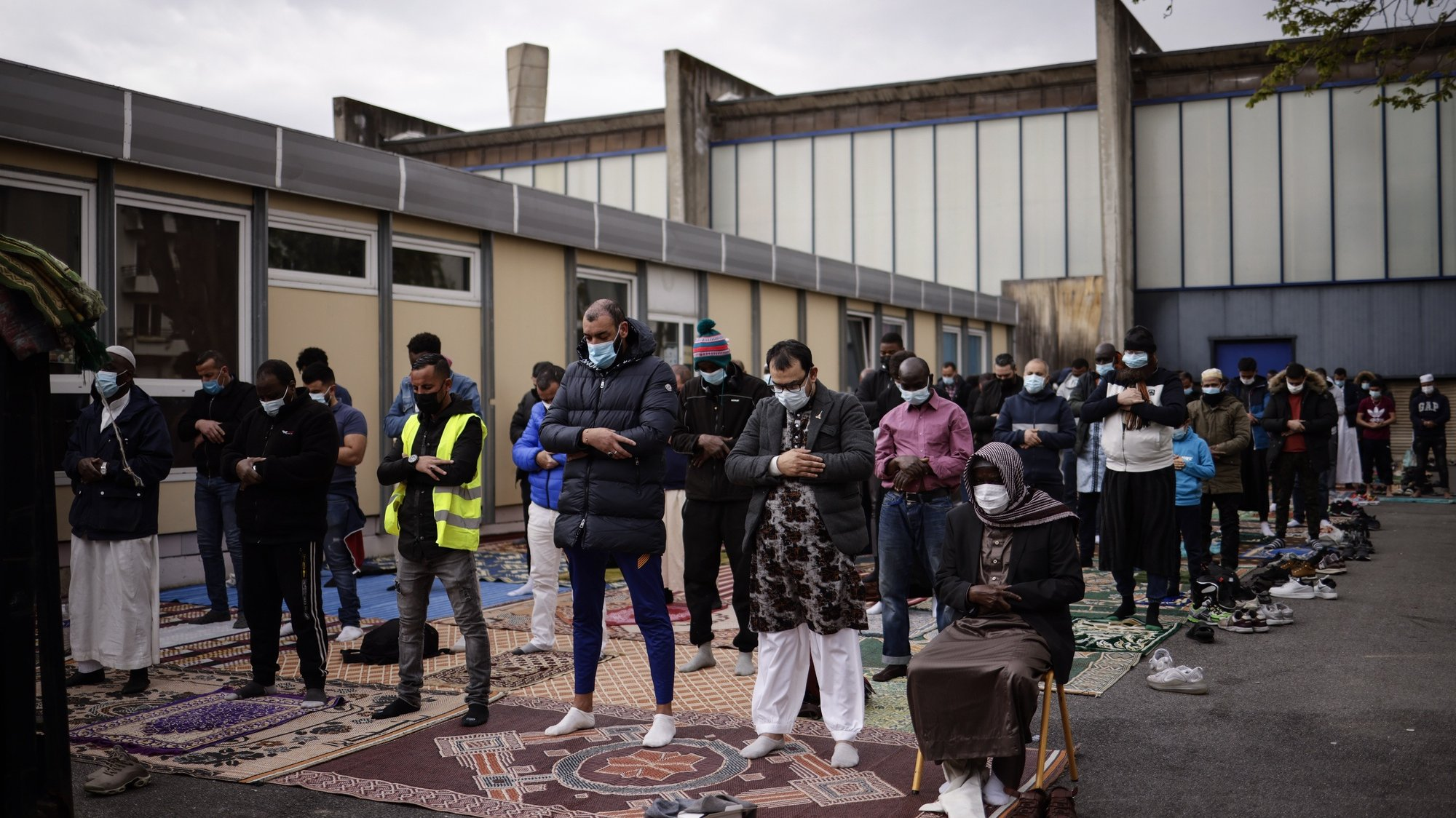 epa09124486 Muslim men preform Friday prayers on the reopening day of the Great Mosque in Pantin, near Paris, France, 09 April 2021. After six months of administrative closure for having relayed video following the terrorist attack and death of French teacher Samuel Party in Conflans-Sainte-Honorine, the Great Mosque of Pantin is now reopened to believers as Muslims around the world prepare ahead of the upcoming fasting month of Ramadan, which begins on 13 April.  EPA/YOAN VALAT
