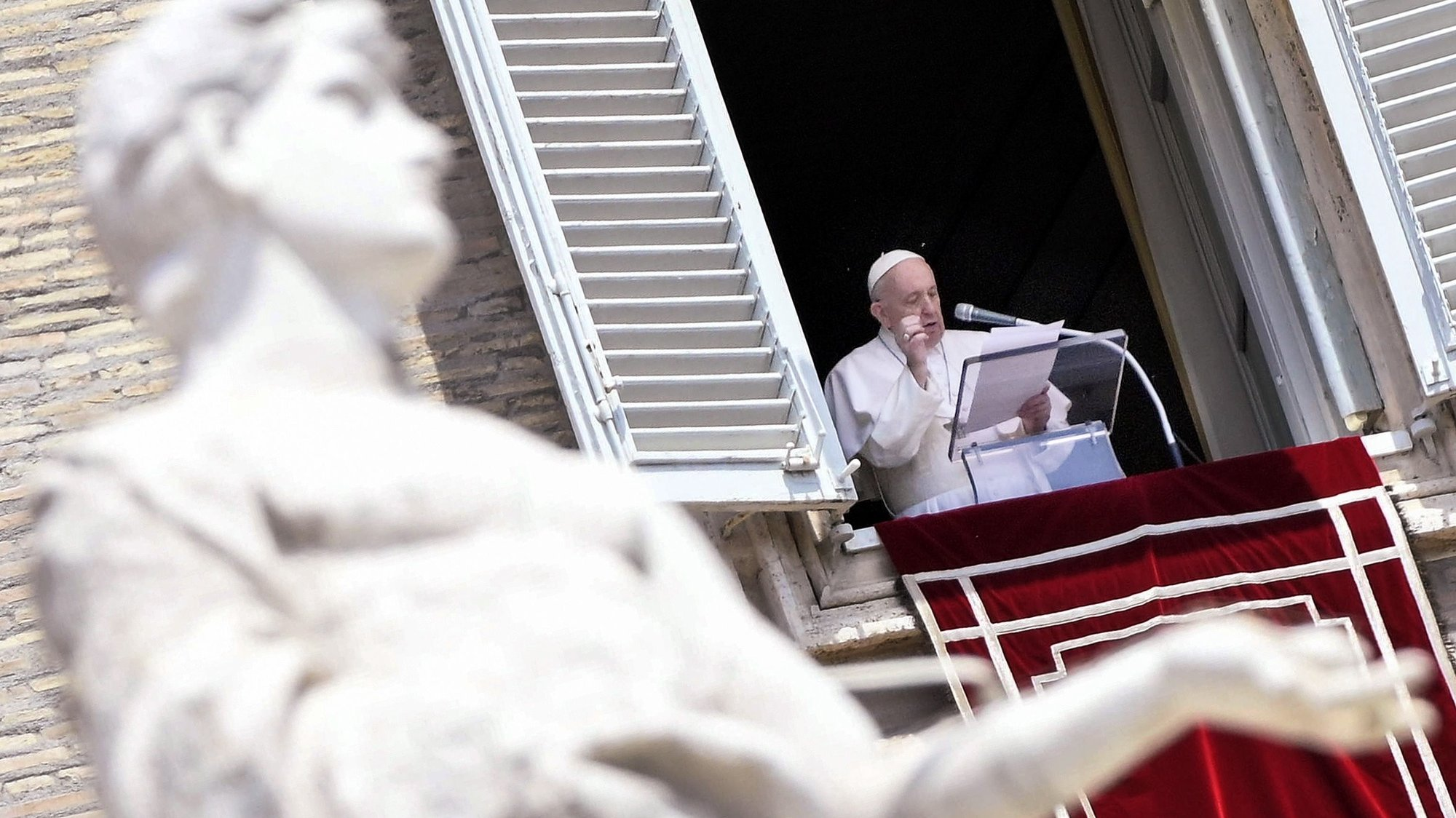 epa09266722 Pope Francis leads his Sunday Angelus prayer from the window of his office overlooking Saint Peter's Square, Vatican City, 13 June 2021.  EPA/CLAUDIO PERI