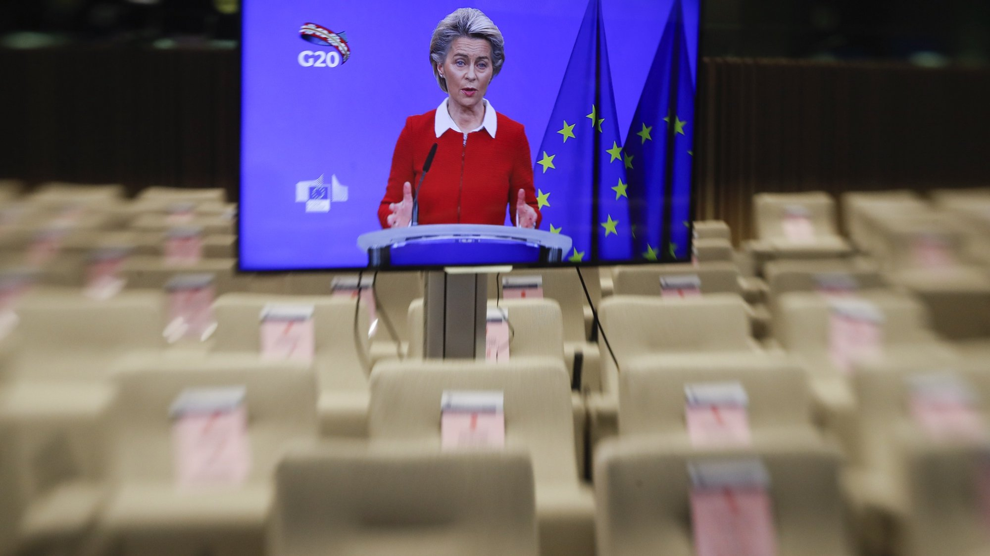 epa08830651 A tiltshift lens image of European Commission President Ursula Von Der Leyen seen on a screen as she along with European Council President Charles Michel (unseen) give a joint press briefing ahead of a G20 online meeting, in Brussels, Belgium, 20 November 2020. The G20 Leaders' Summit will be held virtually on 21 and 22 November and is organized by Saudi Arabia's current G20 Presidency.  EPA/OLIVIER HOSLET / POOL