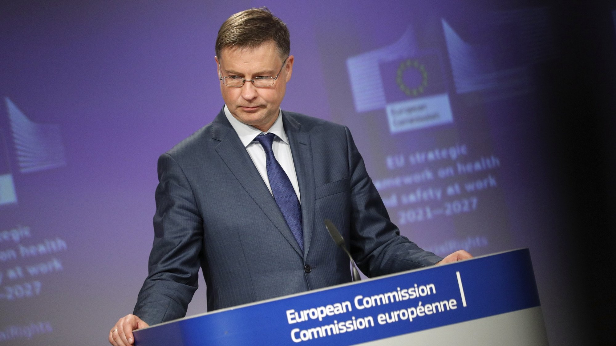 epa09307632 European Commission vice-president Valdis Dombrovskis gives a news conference with Commissioner Nicolas Schmit on communication on a new occupational safety and health strategy framework in Brussels, Belgium, 28 June 2021.  EPA/JOHANNA GERON / POOL