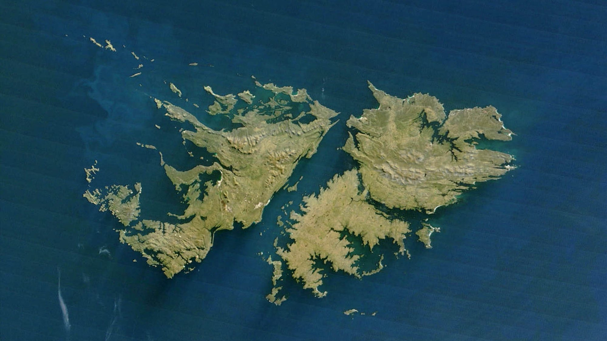 This NASA Terra satellite released 14 July, 2003 shows the Falkland Islands.The Falklands are a small group of islands 480 kilometers (about 300 miles) east of the Strait of Magellan (the straight crossing the southern point of South America). The two main islands are East Falkland and West Falkland, though some 200 small islands are also part of this British-administered colony. The islands are rocky, wet, and windswept, but are ideally suited for sheep-raising. The waters surrounding the islands are home to great whale and seal populations, and were hunted heavily in the not-too-distant past. Fish are also abundant, and besides sheep, the fishing trade is one of the mainstays of this distant island's economy. AFP PHOTO/NASA