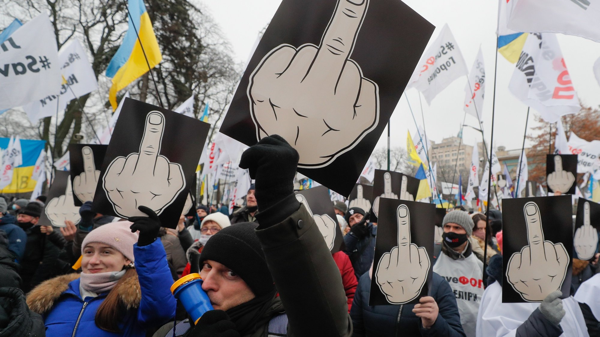 epa08885117 Ukrainian small businessmen attend a rally with the slogan Save FOP (individual-entrepreneurs) in front of Parliament building in Kiev, Ukraine, 15 December 2020. Small businessmen protested against strict quarantine announced by the Government between 08 and 24 January 2021 and demand the abrogation of the amendments to a law about the simplified tax system, which will considerably complicate their ability to manage their businesses, raise their prices for clients and increase the possibility of unjustified fines, according to local media reports.  EPA/SERGEY DOLZHENKO