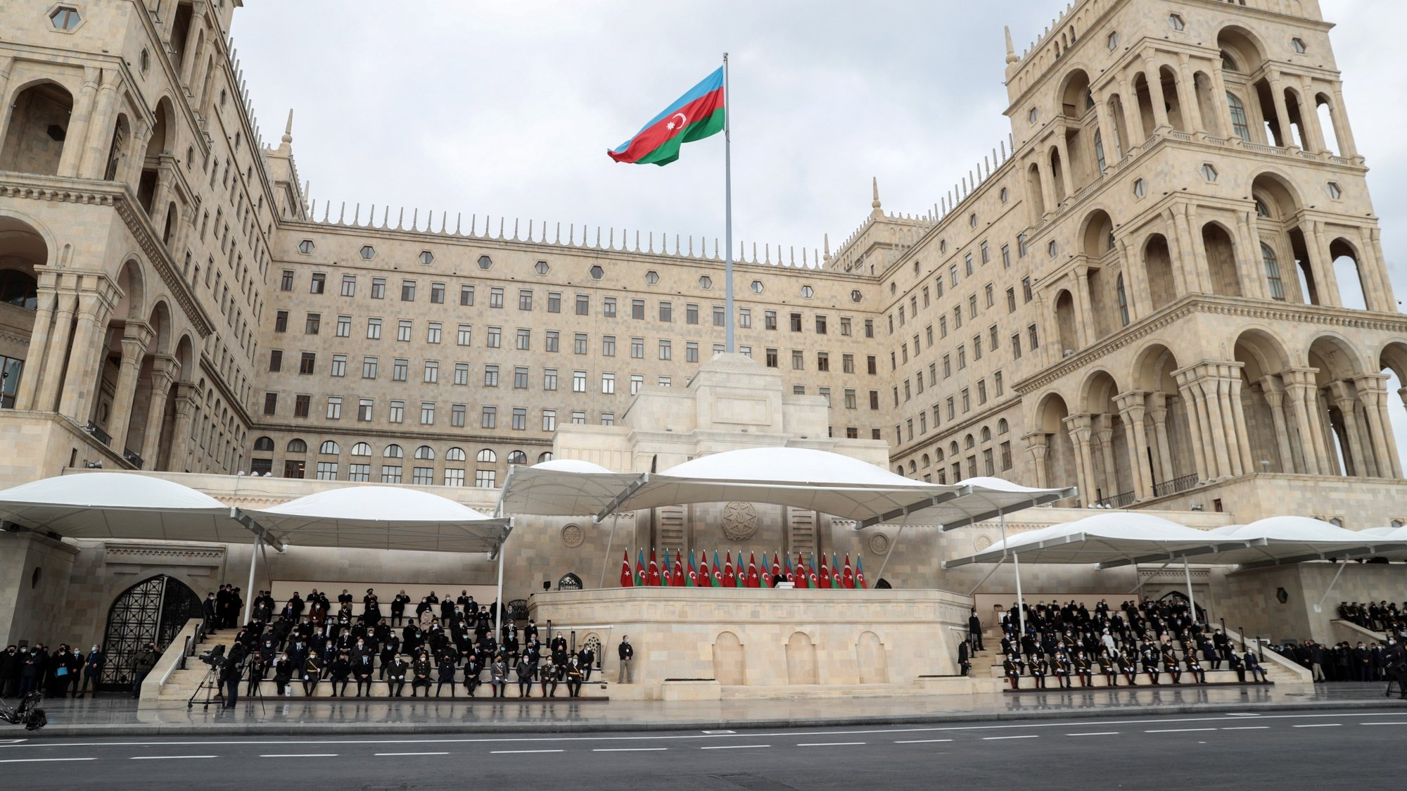 epa08874747 Azerbaijani President Ilham Aliyev (C) attends a military parade dedicated to the victory in the Nagorno-Karabakh armed conflict, in Baku, Azerbaijan, 10 December 2020. The simmering territorial conflict between Azerbaijan and Armenia over Nagorno-Karabakh territory erupted into a war between the two countries on 27 September 2020 along the contact line of the self-proclaimed Nagorno-Karabakh Republic (also known as Artsakh). On 09 November 2020 Presidents of Azerbaijan and Russia and Armenian Prime Minister signed a joint statement announcing a complete ceasefire and halt of all military operations in the Nagorno-Karabakh conflict zone, and return of the Aghdam, Kalbajar and Lachin districts to Azerbaijan.  EPA/POMAN ISMAYILOV
