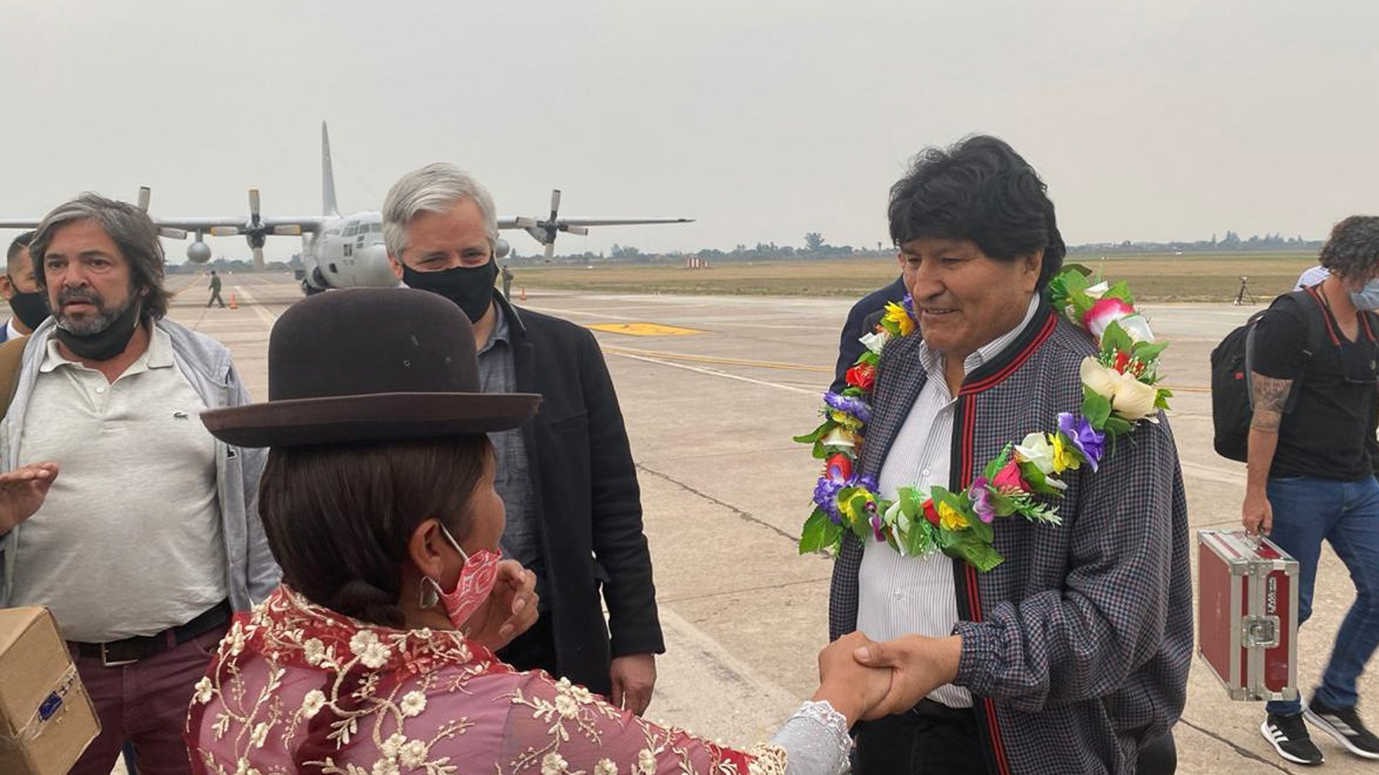 epa08808994 A handout photo made available by Evo Morales press office shows former President of Bolivia, Evo Morales (R), as he greets an indigenous woman upon arrival in the Province of Jujuy, Argentina, 08 November 2020. Morales plans to return to his country after a year of exile, stating that he was forced by a coup. He is expected to be received by a caravan as soon as he enters Bolivia from the border with Argentina, where he has remained since his departure from his home country.  EPA/EVO MORALES PRESS OFFICE / HANDOUT  HANDOUT EDITORIAL USE ONLY/NO SALES