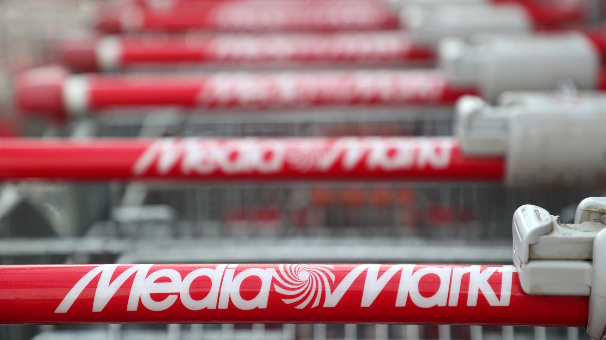 epa07366552 Mediamarkt logo on a shopping trolley at a Mediamarkt during the company's general assembly meeting in Duesseldorf, Germany, 13 February 2019. Ceconomy AG is a listed German trading company and operates the consumer electronics chains Mediamarkt and Saturn.  After a crisis year, the electronics trading holding Ceconomy prepares its shareholders for hard cuts, the share had lost two thirds of its value last year.  EPA/FRIEDEMANN VOGEL